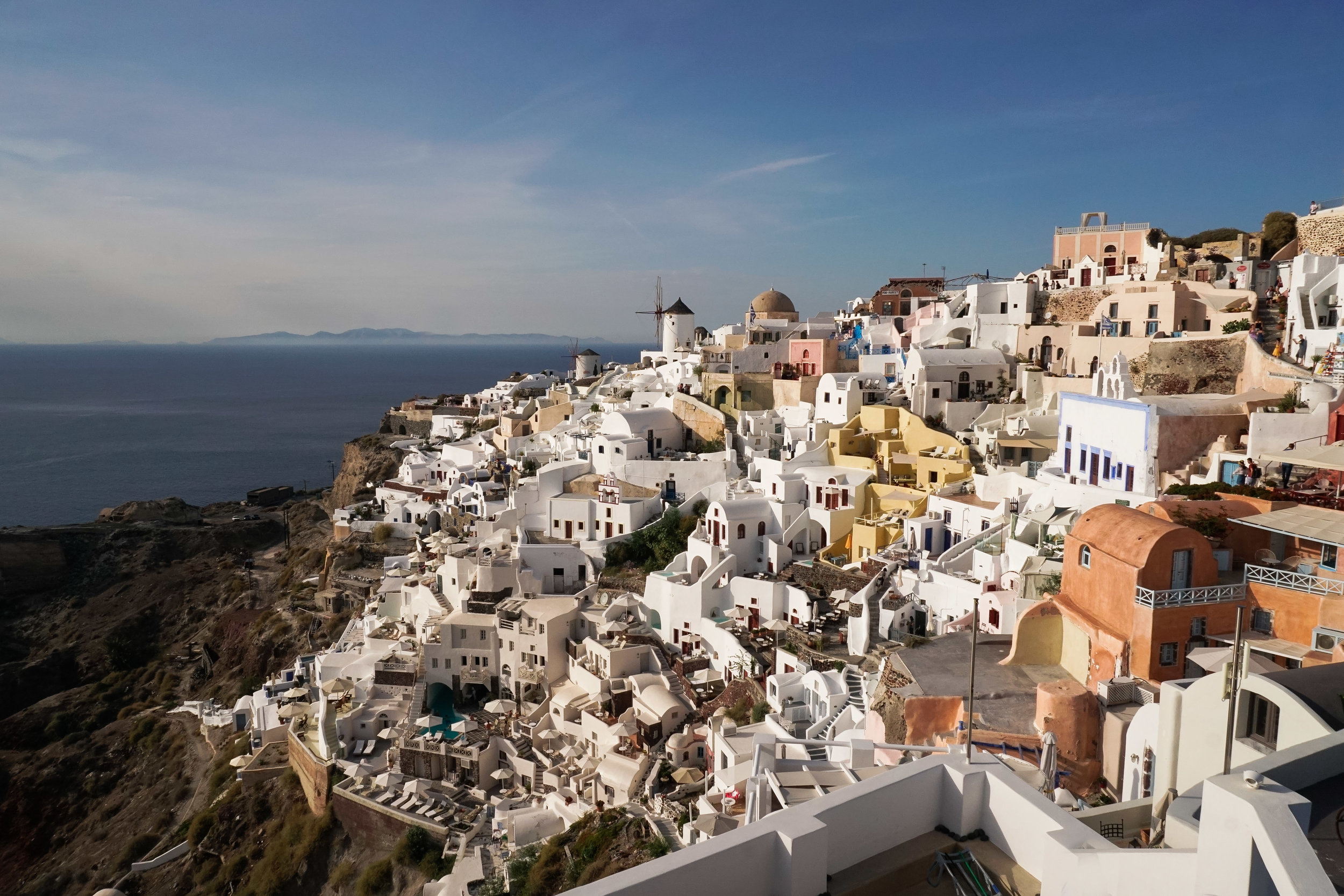curio.trips.greece.santorini.windmill.view.day.landscape.jpg