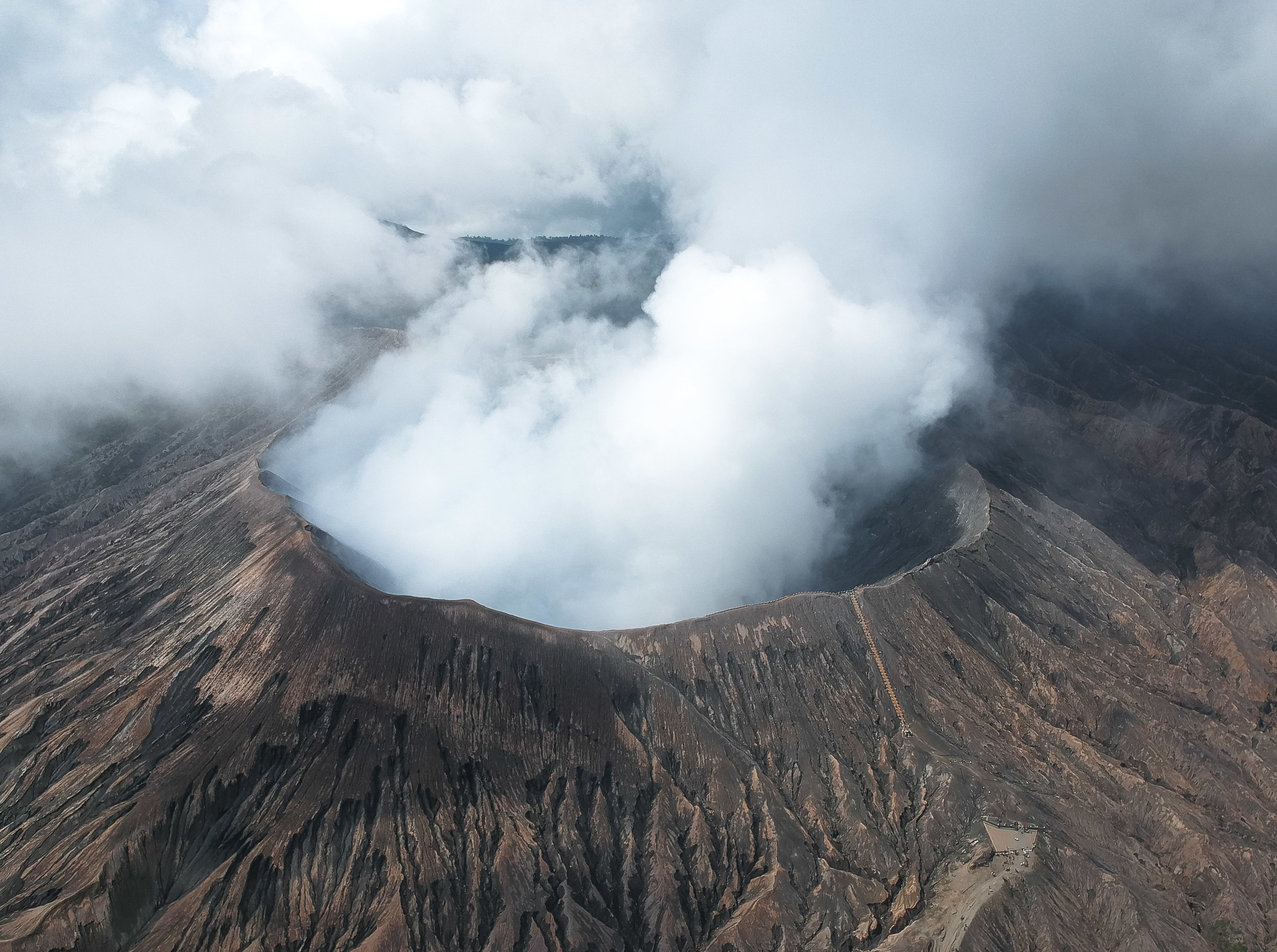 curio.trips.indonesia.java.smoking.volcano.crater.drone.jpg