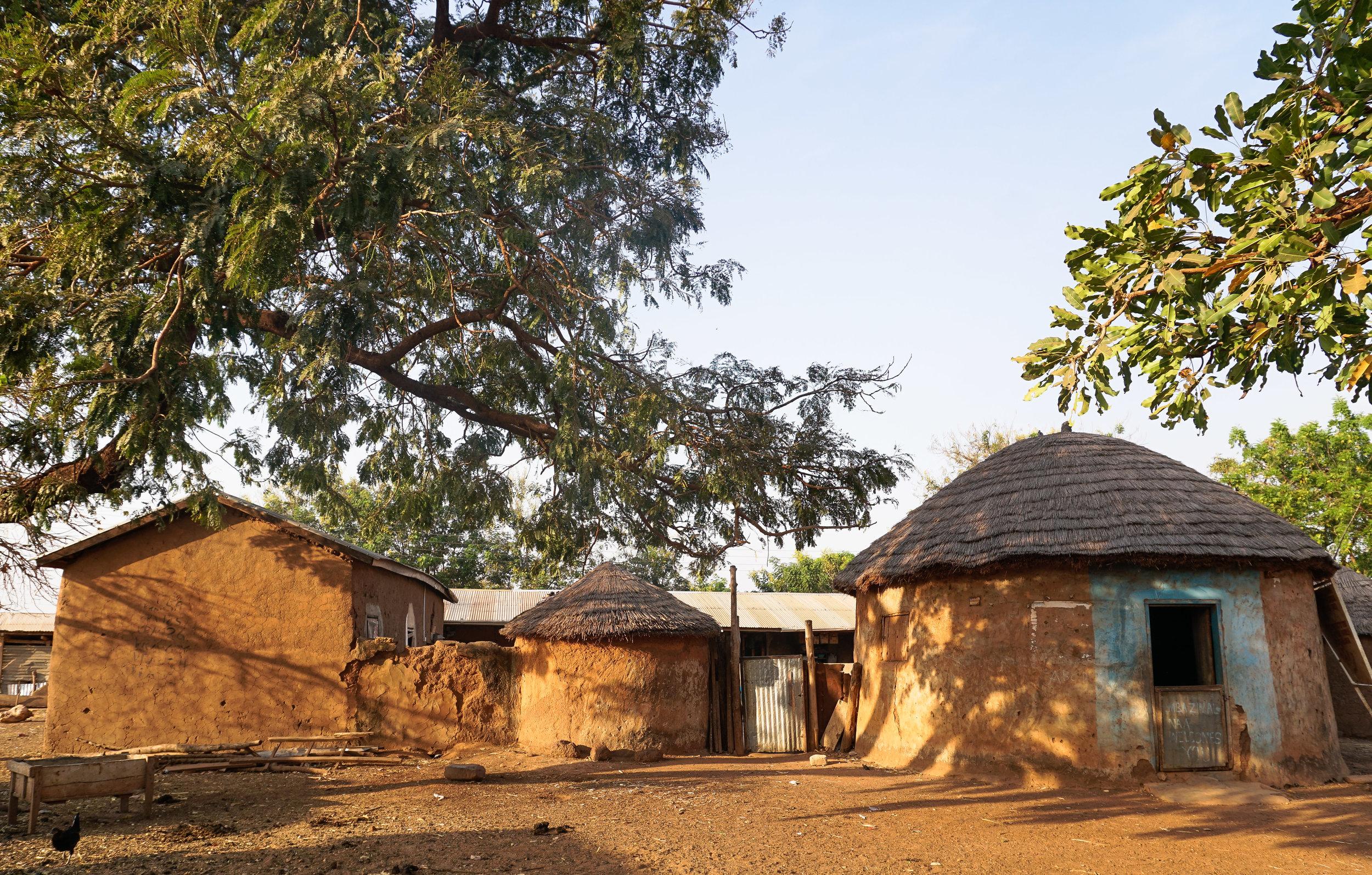curio.trips.ghana.village.compound.sun.landscape.jpg