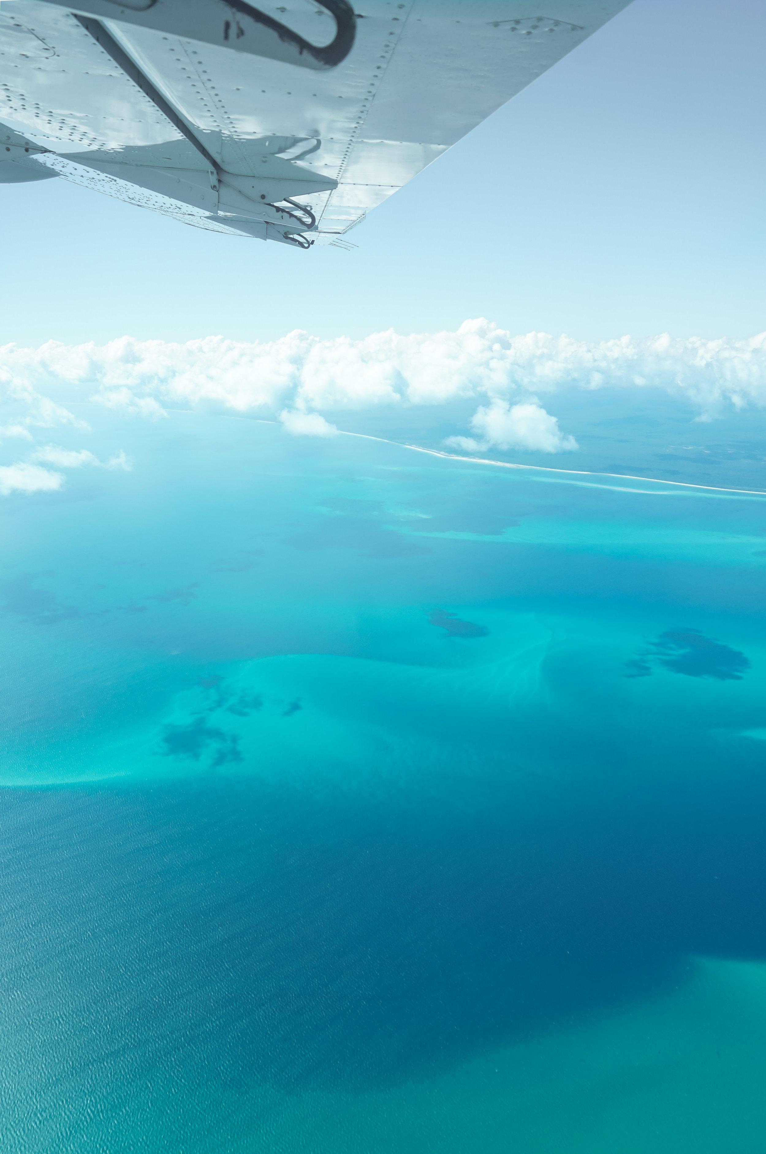 curio.trips.australia.great.barrier.reef.flight.plane.wing.view.portrait.jpg