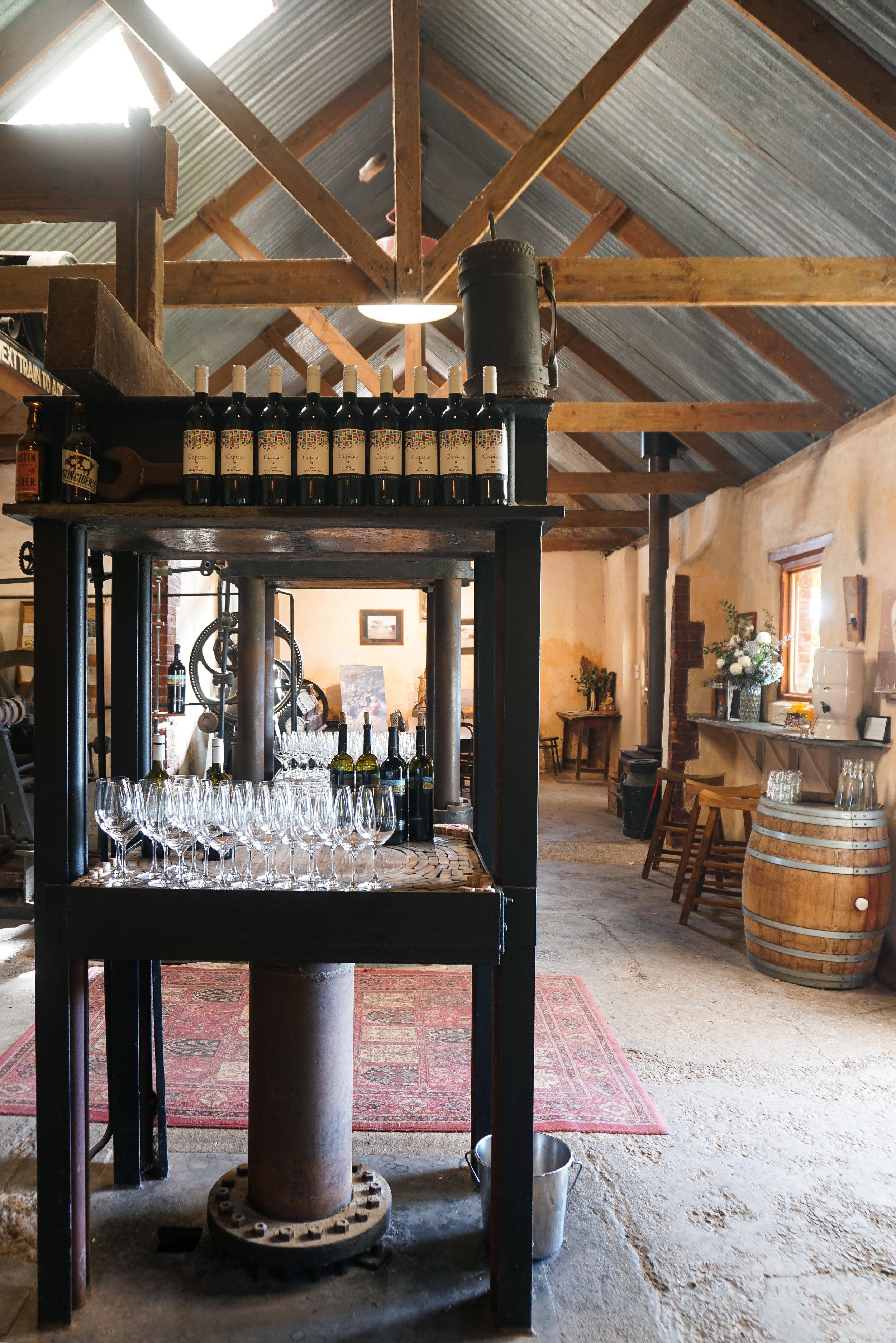curio.trips.australia.south.winery.interior.glasses.portrait.jpg