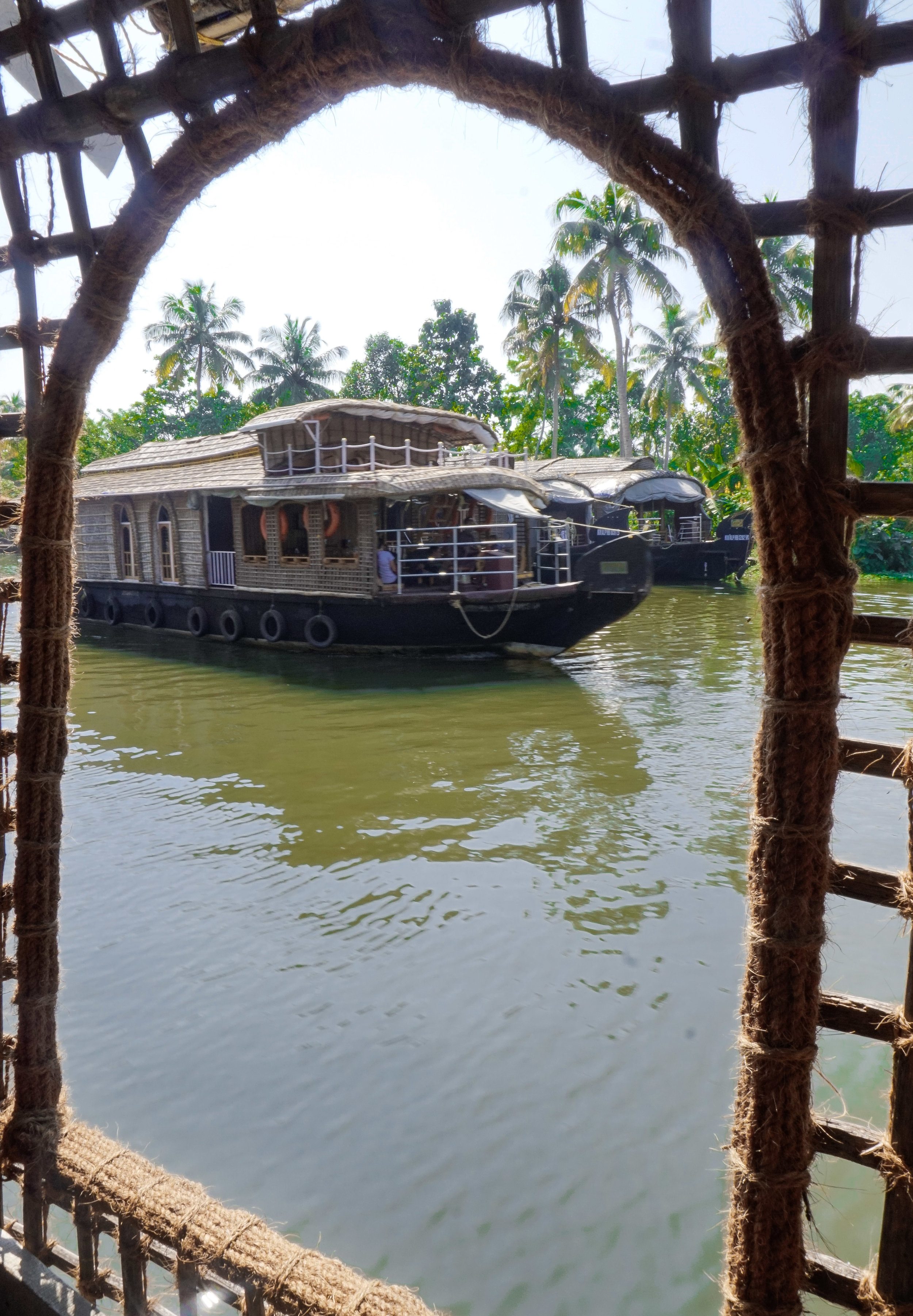 curio.trips.india.kerala.house.boat.window.portrait.jpg