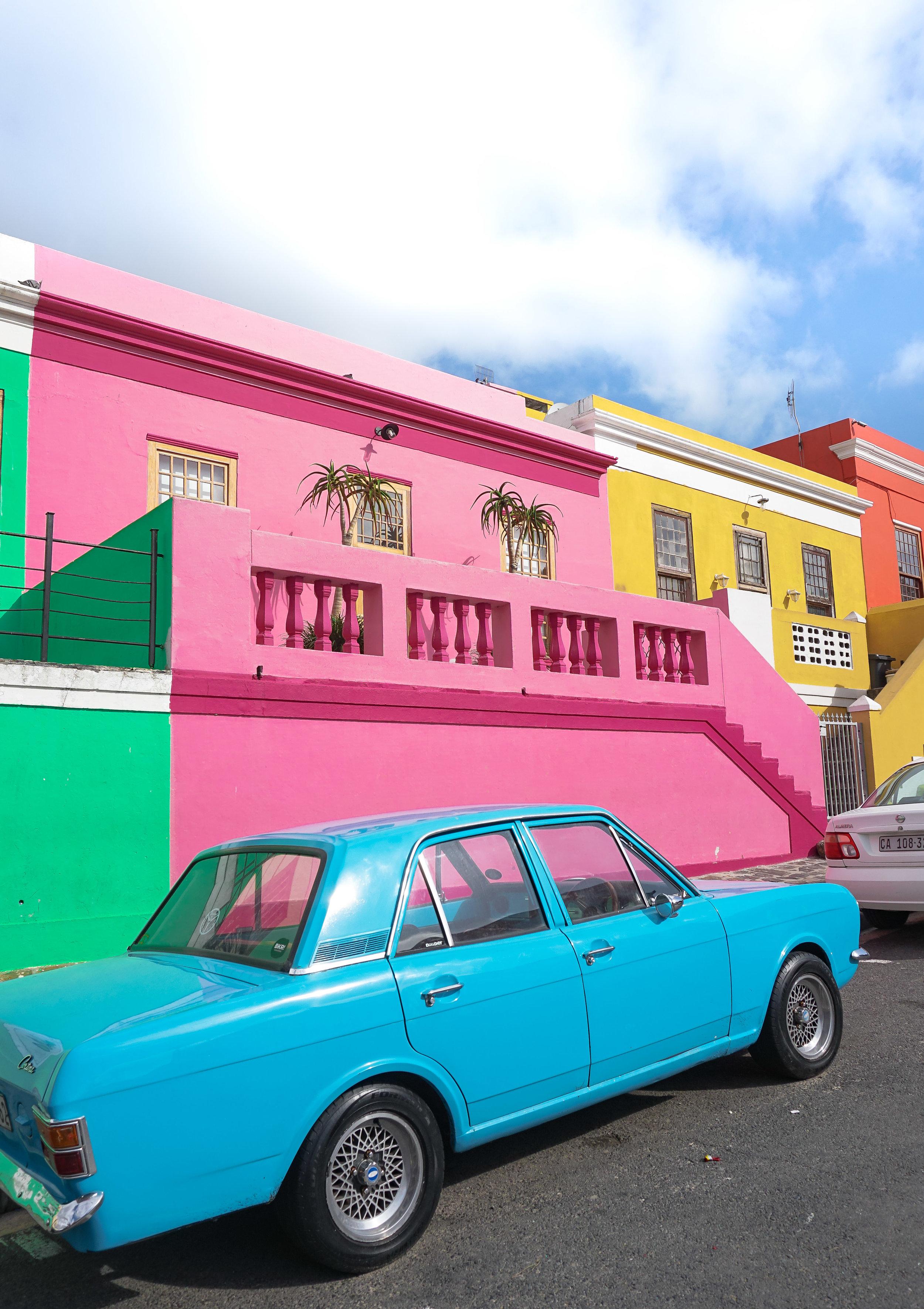 curio.trips.south.africa.bo.kaap.colourful.houses.blue.car.portrait.jpg