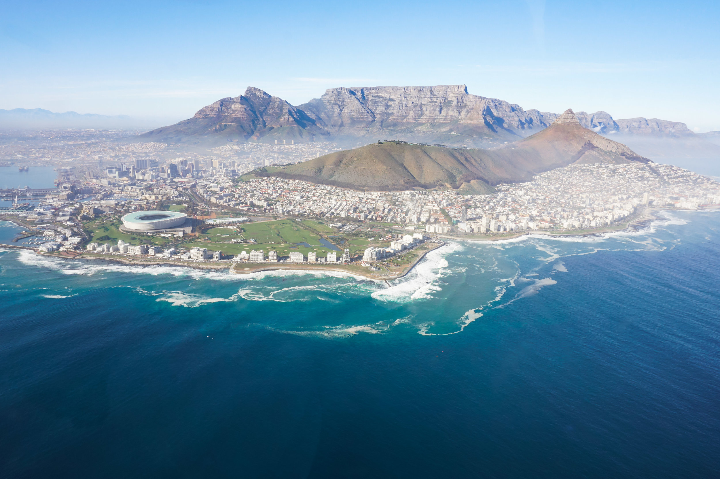 curio.trips.south.africa.cape.town.helicopter.flight.stadium.lions.head.table.mountain.landscape.jpg