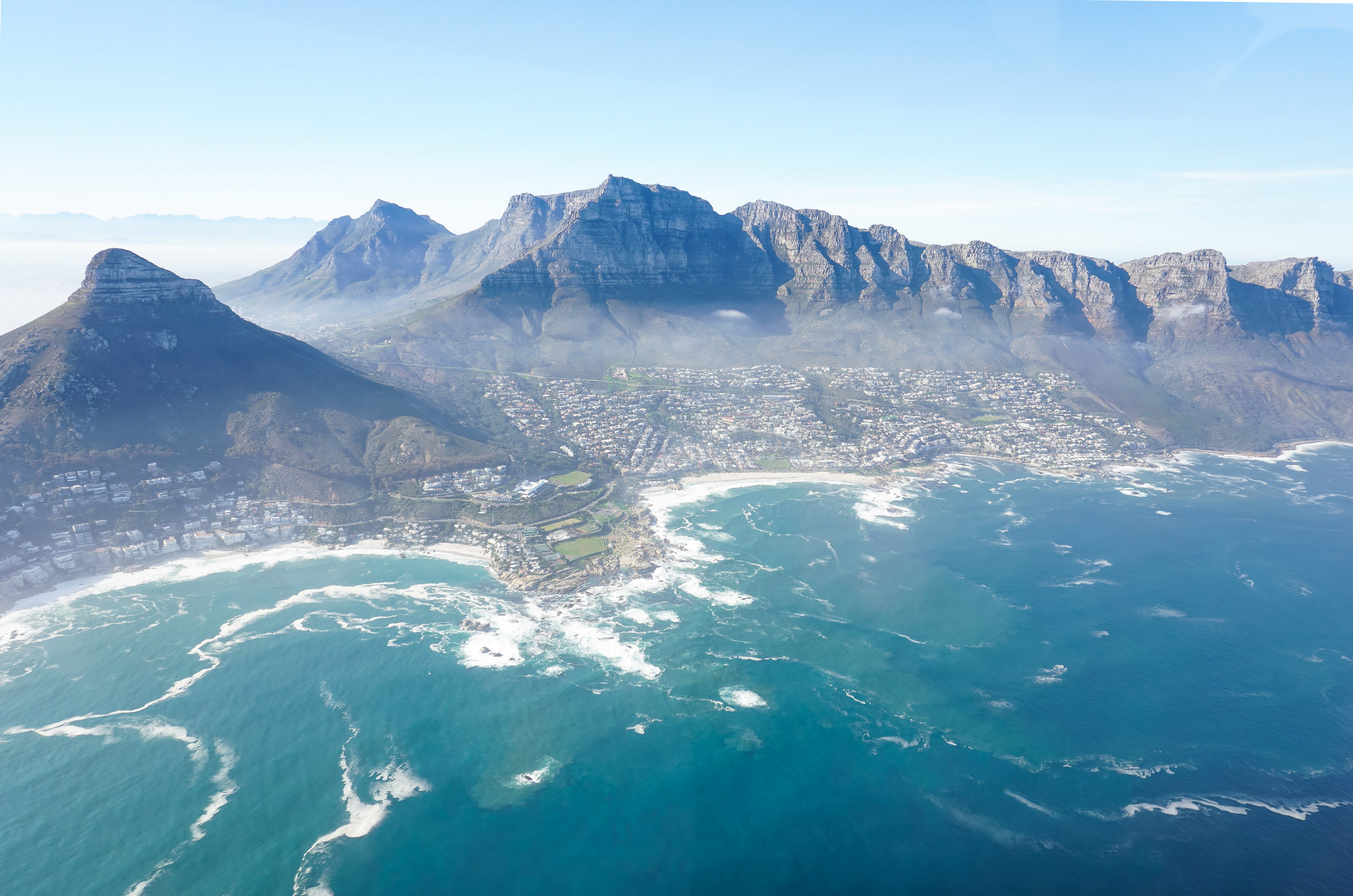 curio.trips.south.africa.cape.town.helicopter.flight.lions.head.table.mountain.twelve.apostles.landscape.jpg