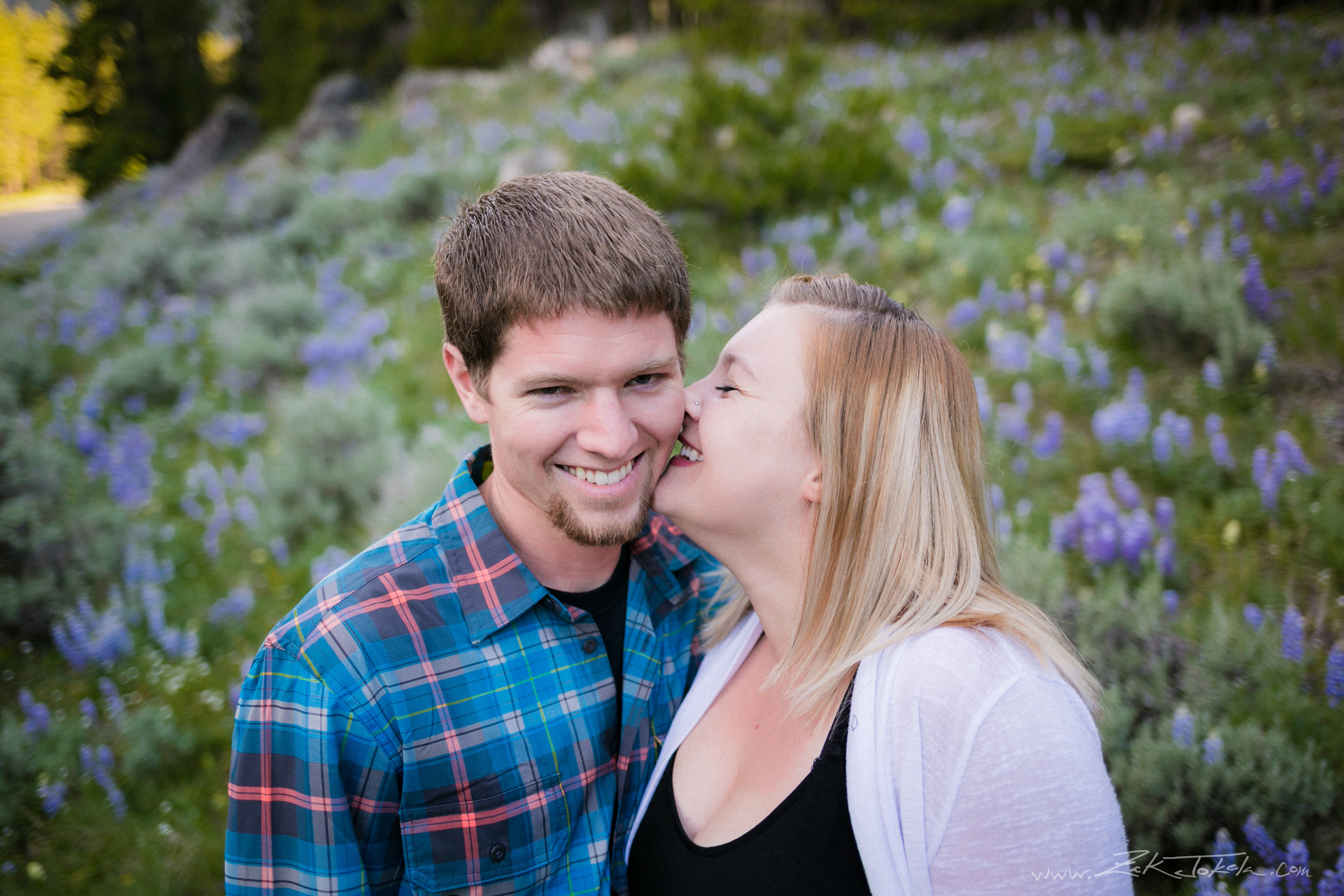 Engagement photo with wild flowers at Lake Fork Trailhead, just outside Red Lodge, Montana.