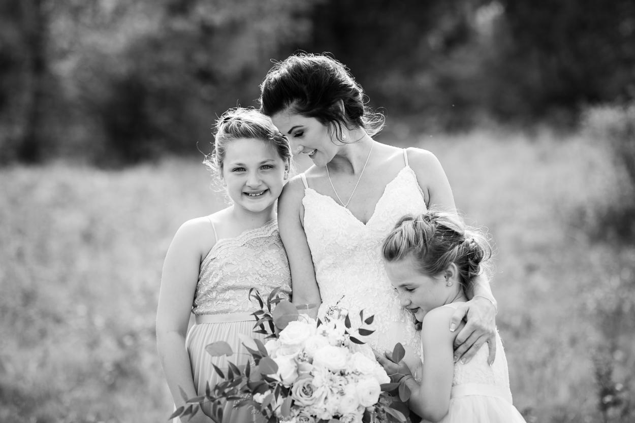 Bride with flower girls on wedding day.