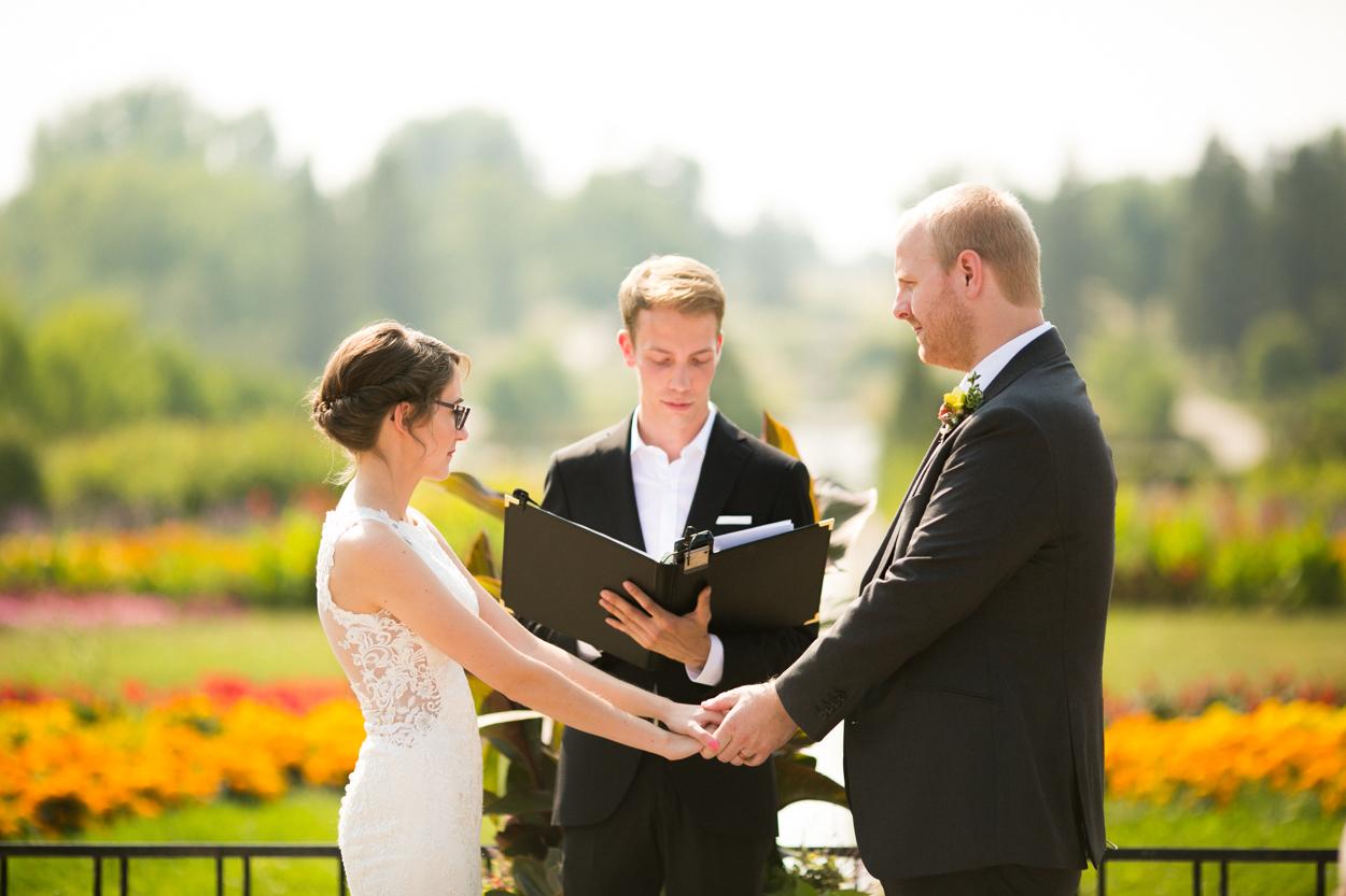Bride and groom during wedding in North Dakota Peace Gardens.