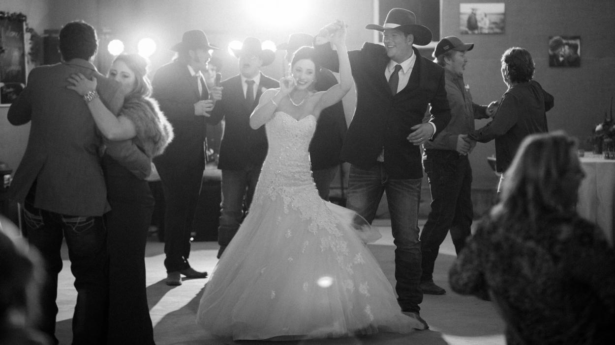 Bride dances with groom at wedding.