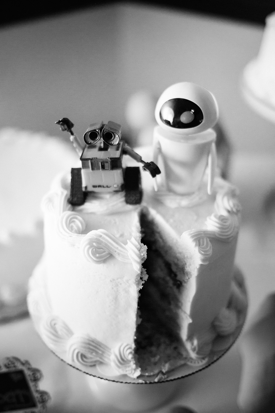 Wedding cake with a piece missing, I bet Wall-e ate it!