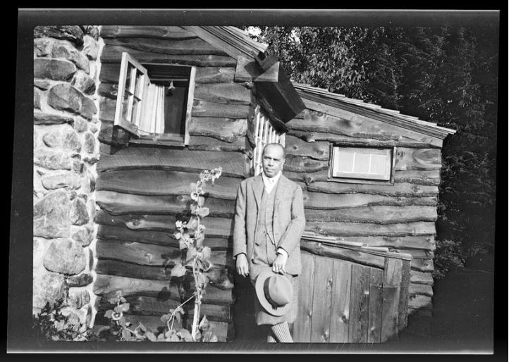 James Weldon Johnson at the Writing Cabin, Five Acres, Great Barrington, circa 1930-1936 (JAMES WELDON JOHNSON MEMORIAL COLLECTION, YALE UNIVERSITY BEINECKE RARE BOOKS & MANUSCRIPT LIBRARY)