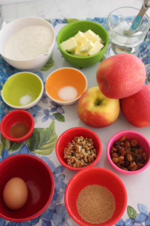 Ingredients - Pastry:1½ cup all-purpose flour8T butter, cut into cubes and cold¼ tsp. salt1 tsp. granulated sugar8T iced, cold waterFilling: 3-4 medium size apples (about 1½ pounds): (gala, pink lady, or pipen)2T brown sugar1 tsp. cinnamon¼ cup raisins ¼ cup walnuts, roughly chopped1 egg, beaten2T turbinado or Demerara sugar