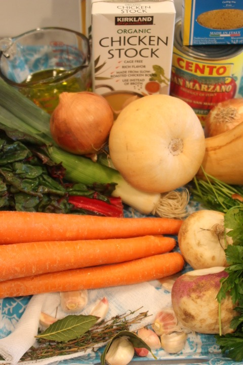 Ingredients - Soup:¼ cup olive oil2 leeks (white & light green part, medium dice)2 medium onions, medium dice1 small square (4-inch) piece of cheesecloth4 sprigs thyme2 bay leaves4 cloves garlic2 cups carrots, (about 4 medium sized carrots)2 cups butternut squash, (about 1 medium squash)2 cups turnips, about 2 medium3 quarts chicken or vegetable stock1 28 oz. can tomatoes with the juice, broken into pieces2 cups kale, chard, or spinach chopped (1 small bunch)½ cup small shaped pasta or spaghetti, broken into pieces salt and pepperPistou:4 cloves garlic, peeled2 cups loosely packed parsley leaves½ cup olive oil