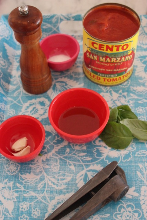 Ingredients - 2T olive oil2 cloves garlic, crushed1 28 oz. can whole tomatoes3-4 basil leaves salt & pepper