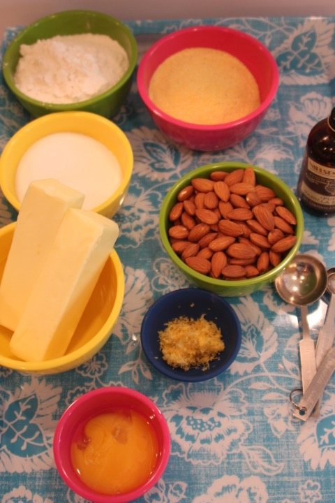 Ingredients - 1½ cups whole raw almonds plus 12 almonds for decoration1½ cups all-purpose flour1 cup finely ground corn meal1 cup granulated sugar2 sticks of butter2 eggs yolkszest of 1 lemon1 tsp. vanilla