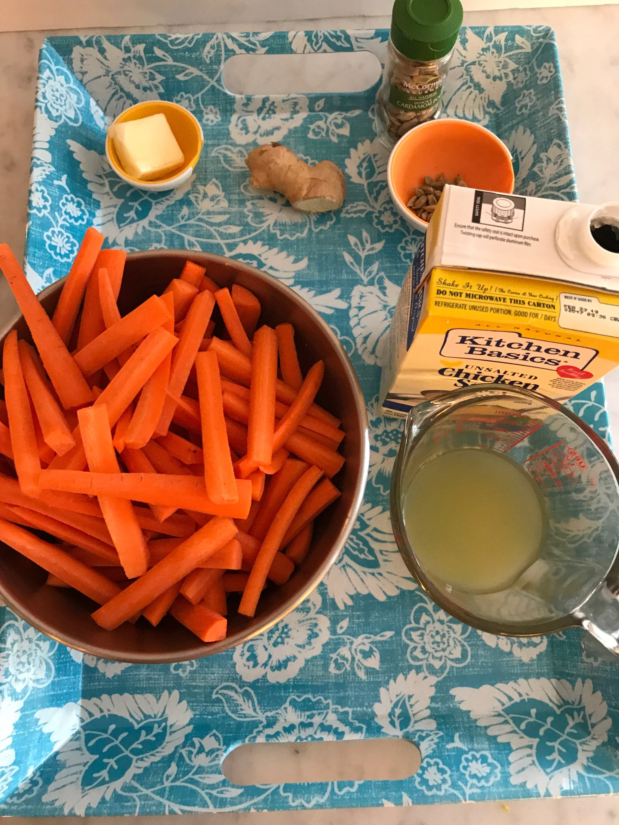 Ingredients - 2T unsalted butter1-inch piece ginger root, peeled and cut into pieces1T cardamom seeds2 pounds carrots, peeled, trimmed, and cut into sticks about 2 inches longsalt & pepper½ cup chicken stock