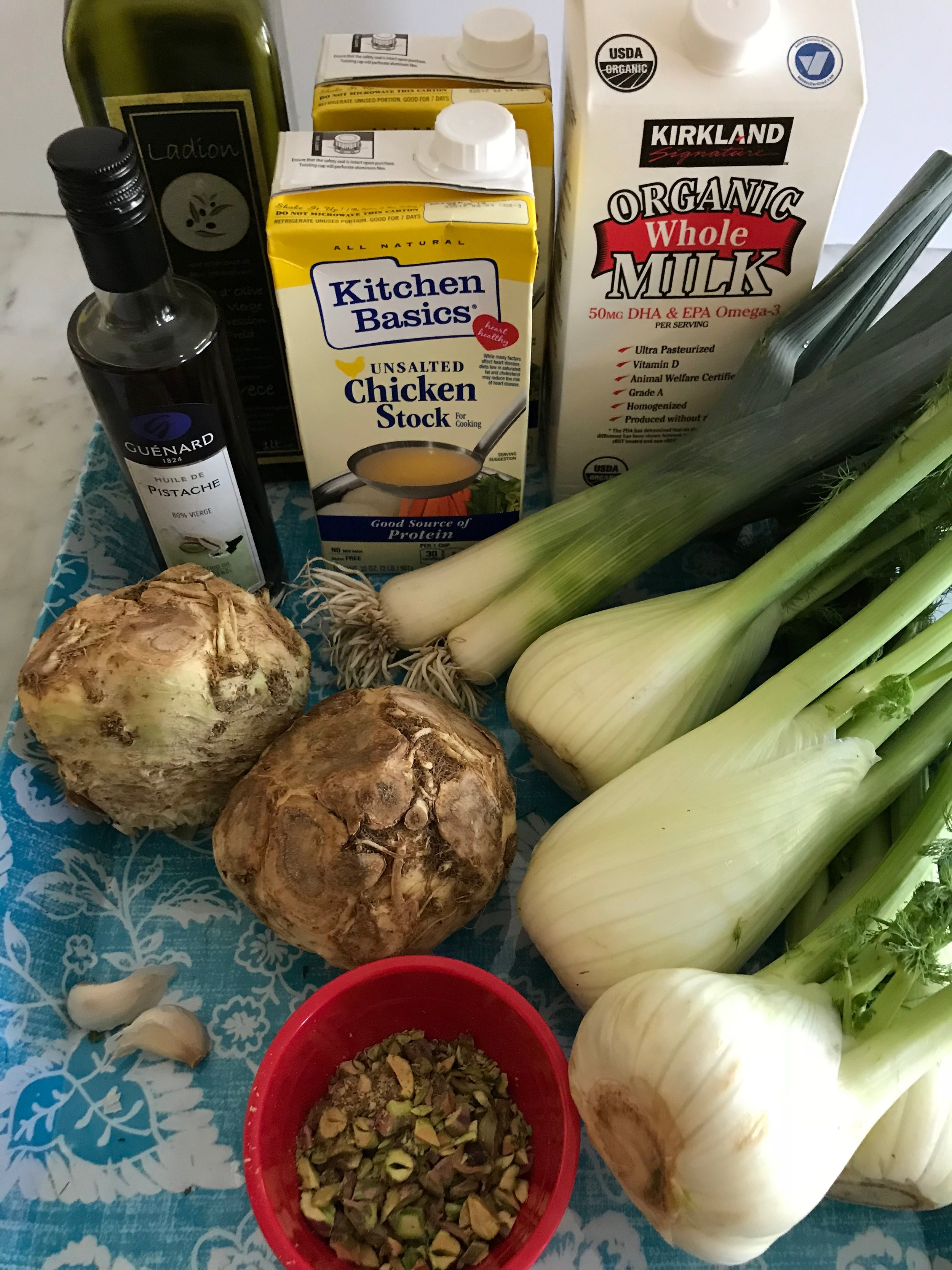 Ingredients - 2 leeks2 large celery roots4 medium heads of fennel2T olive oil3 cloves garlic 7 cups chicken or vegetable stock2 cups milk Salt & pepper½ cup chopped pistachios5T olive or pistachio oil