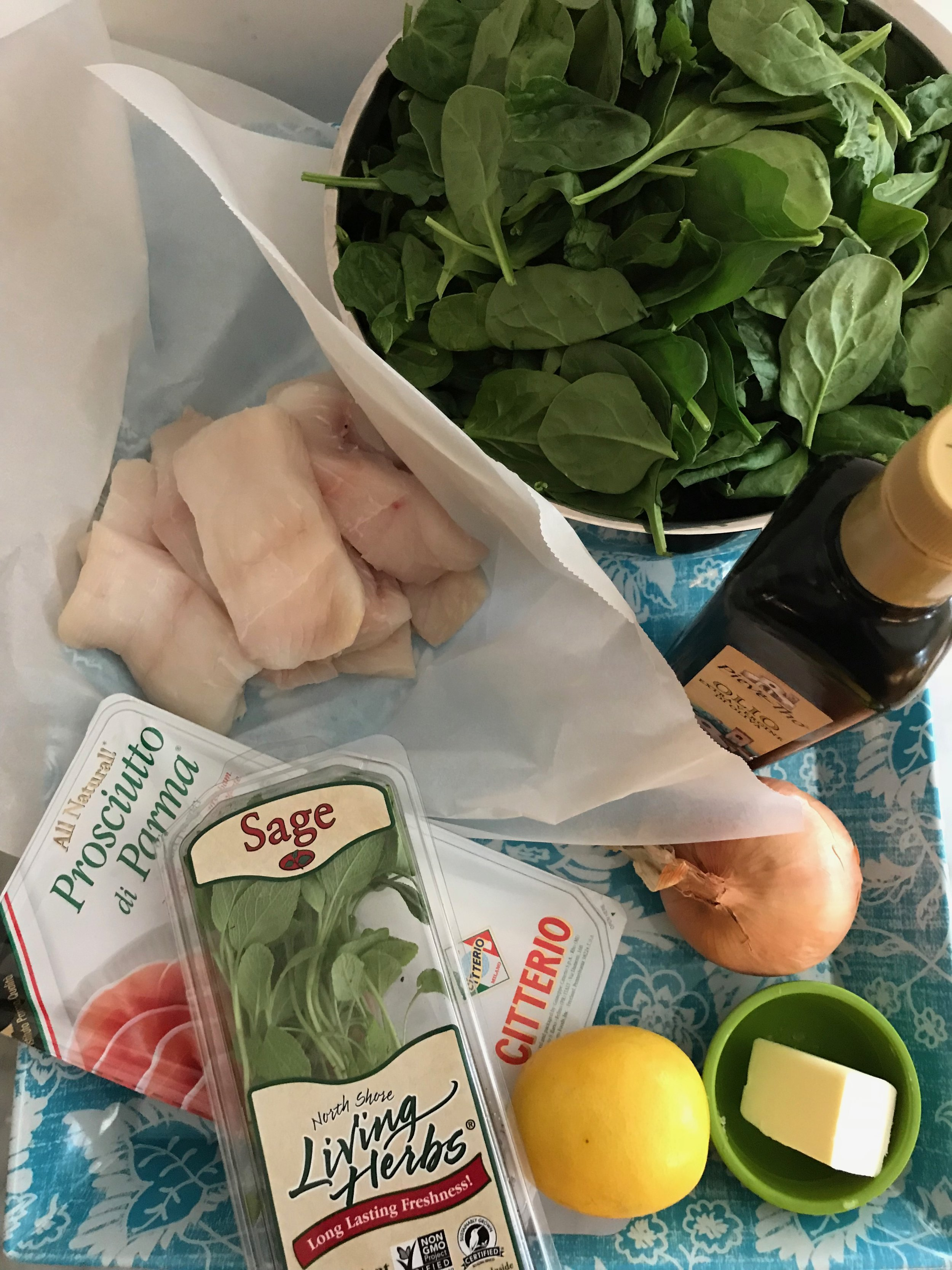 Ingredients - Fish:8 6 oz. skinless fish filets, about 1 inch thick8-16 leaves fresh sage8 thin slices Prosciutto di ParmaSpinach:3T olive oil1 medium onion, finely diced2 lbs. spinach (12 cups), washed, drained and slightly dampsalt and pepperSauce:3T butter3-4 fresh sage leaves4T fresh lemon juice