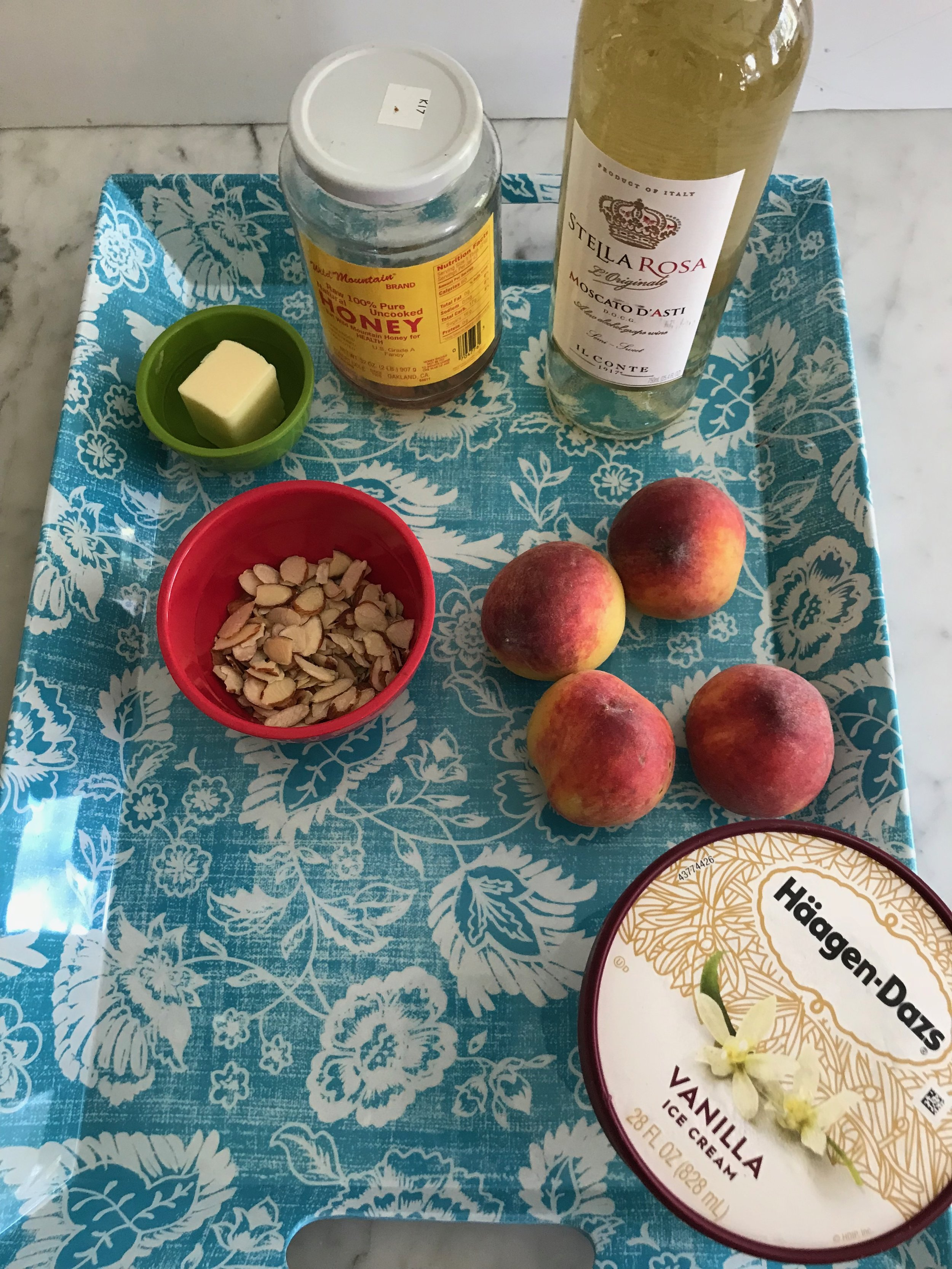 """Ingredients - 3T unsalted butter6T honey½ cup Moscato wine4 peaches pitted and sliced into ½"""" thick slices, about 3 cups.½ cup sliced almonds1 quart vanilla ice cream"""