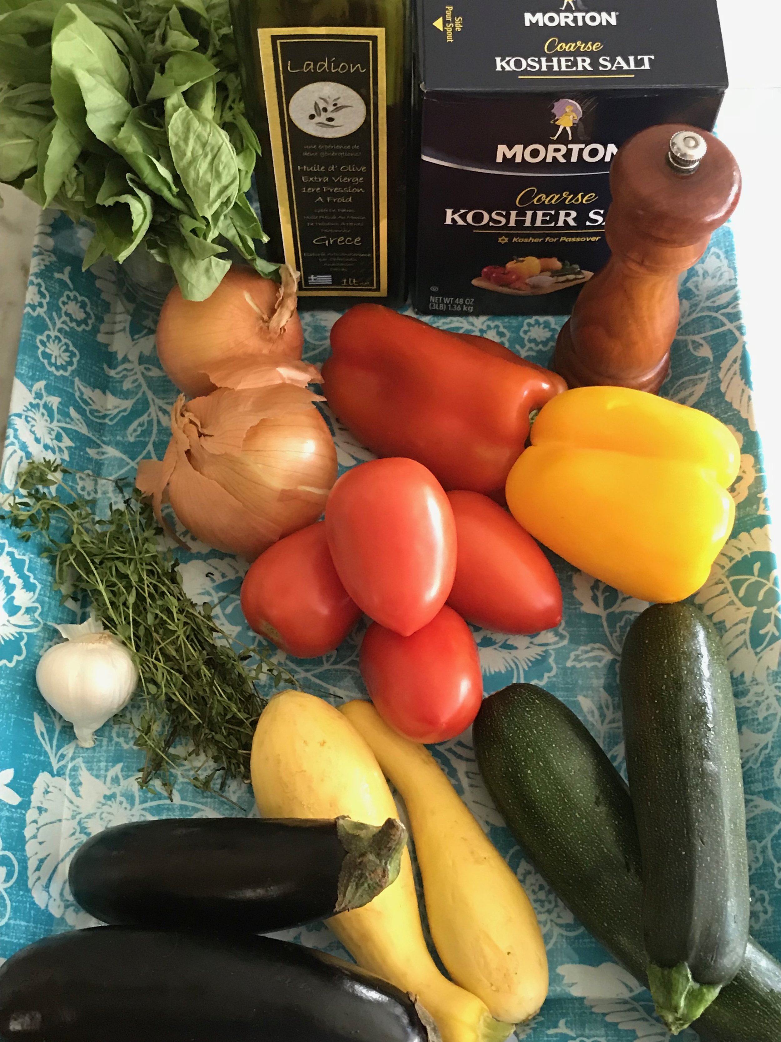 "Ingredients - ¼ cup olive oil2 medium onions, cut in half and sliced into thin ½ moons, about ¼"" thick1 red pepper1 yellow pepper2 cloves garlic, crushed2 Italian, Japanese, or small eggplant2 medium zucchini squash2 medium yellow squash4 Roma tomatoesSalt & pepper2T fresh thyme2T olive oil 2T fresh basil, chiffonade"