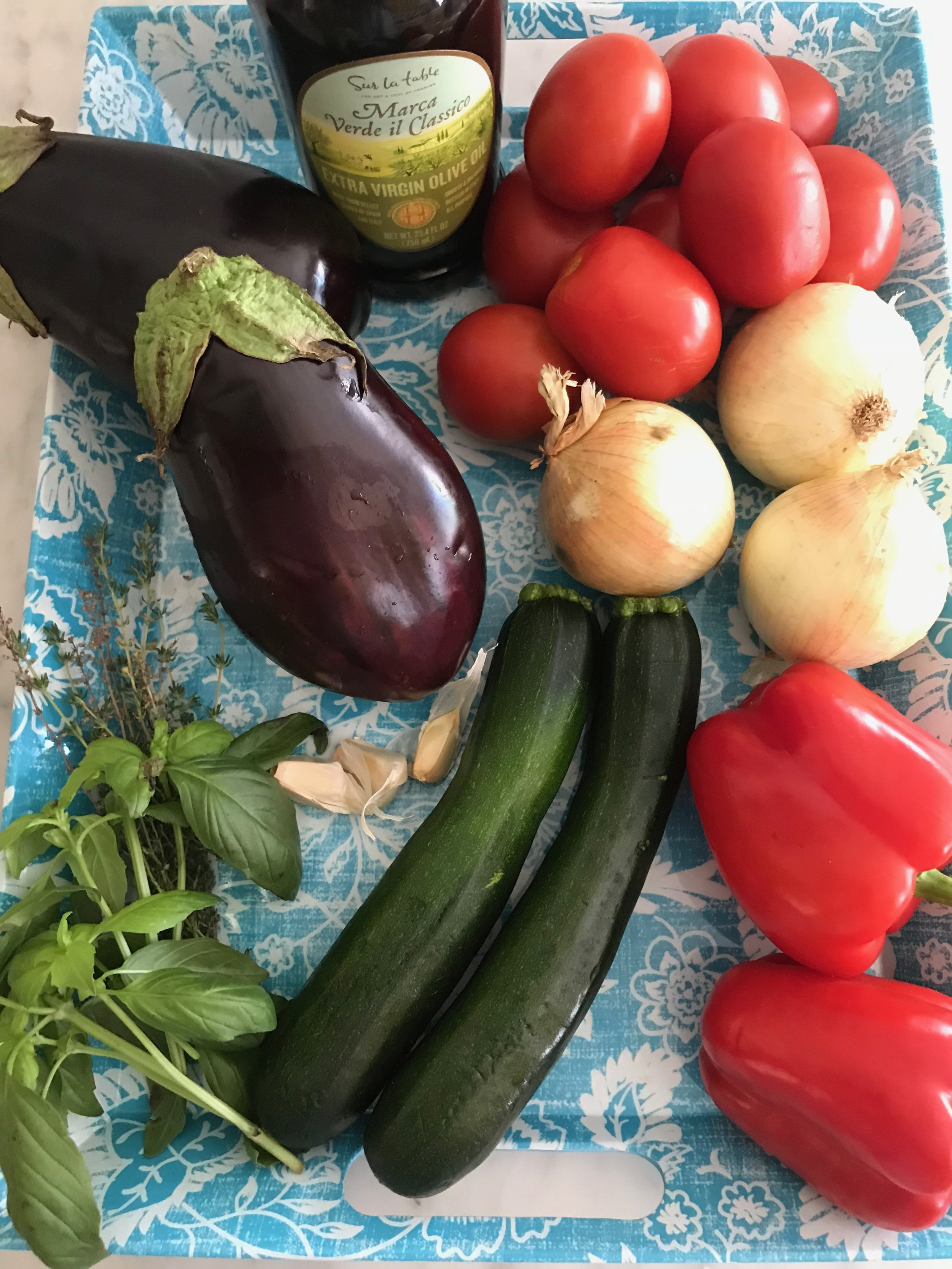 Ingredients - ¼ cup olive oil3 onions2 medium Italian or globe eggplants2 red peppers4 medium zucchini2 pounds Roma tomatoes, (or one 14oz can diced tomatoes)3 cloves garlic, crushed2T fresh thymeSalt & pepper2T fresh basil, chiffonade