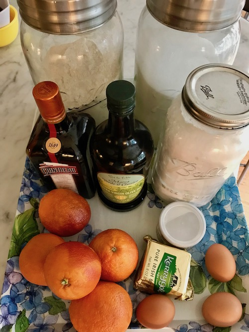 Ingredients - 1T butter, room temperature1T all-purpose flour3 eggs1 cup sugar3 cups all-purpose flour1T baking powder1T orange zest3T orange juice¾ cup good quality olive oil2/3 cup milkConfectioner's sugar for dusting4 oranges, peeled, sliced into ½ moons2T granulated sugar4T Cointreau or Grand Marnier