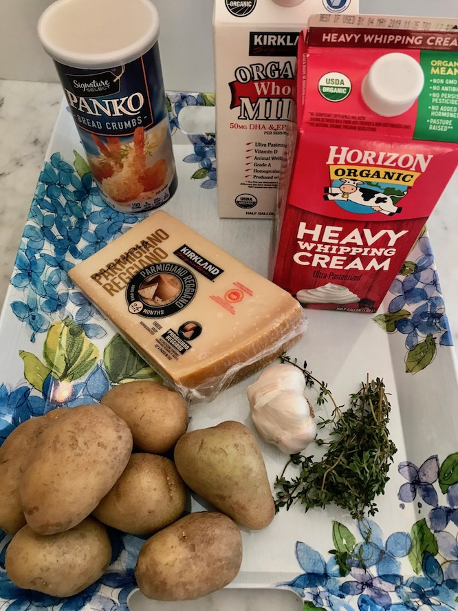 Ingredients - 1 ½ cup milk1 cup heavy cream2 cloves garlic, crushed4 sprigs fresh thyme1 cup dried breadcrumb, or panko½ cup grated Parmigiano - Reggiano cheesesalt & pepper2 pounds Yukon Gold potatoes