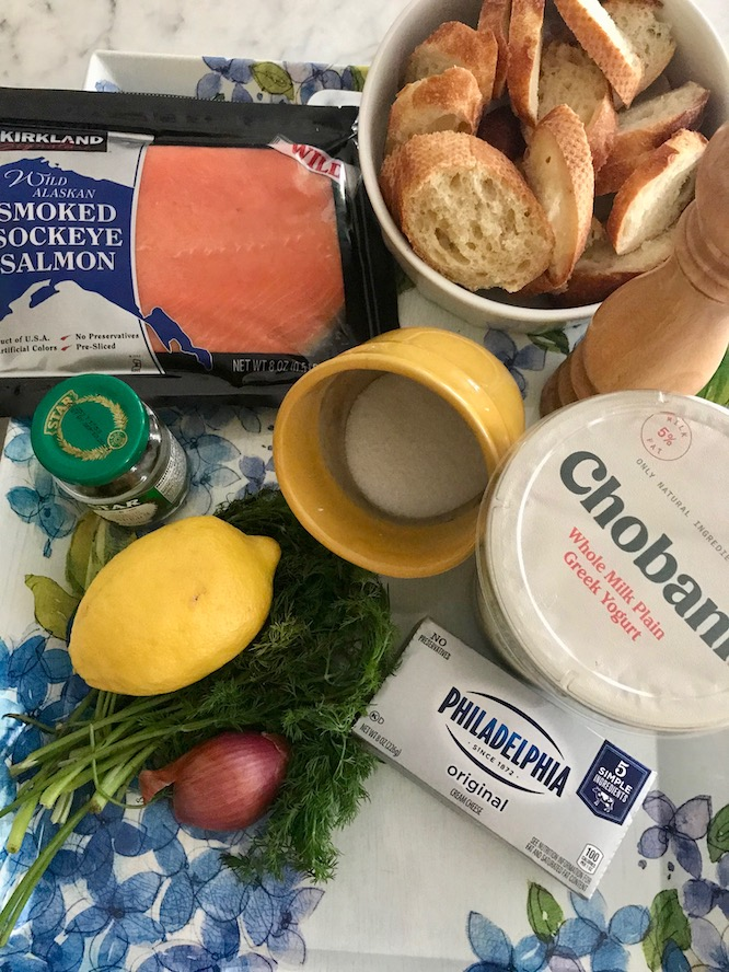 Ingredients - 1 baguette, sliced into 16 pieces diagonally¼ c olive oil4 oz. cream cheese, room temperature8 oz. smoked salmon, chopped1 shallot, finely chopped1 T lemon zest2 T lemon juice½ cup Greek nonfat yogurt1T fresh dill finely choppedsalt & pepperfresh dill and capers for garnish