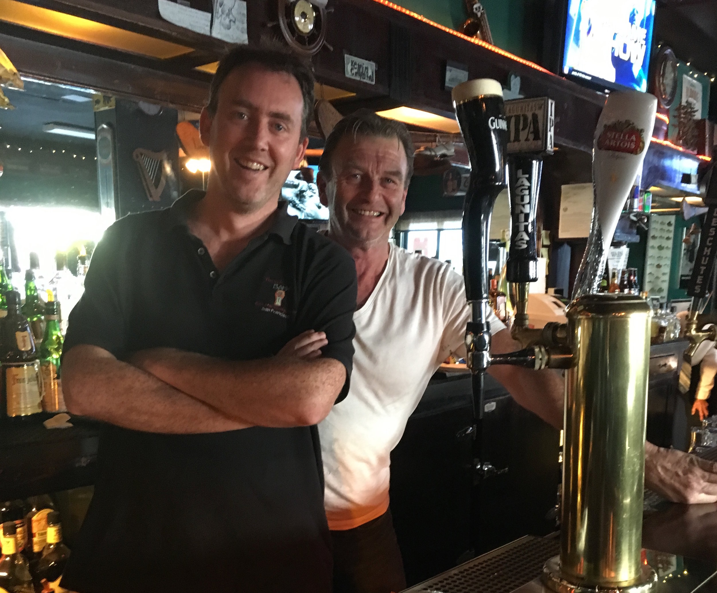 Ronan O'Neill and Peter Friel working the bar
