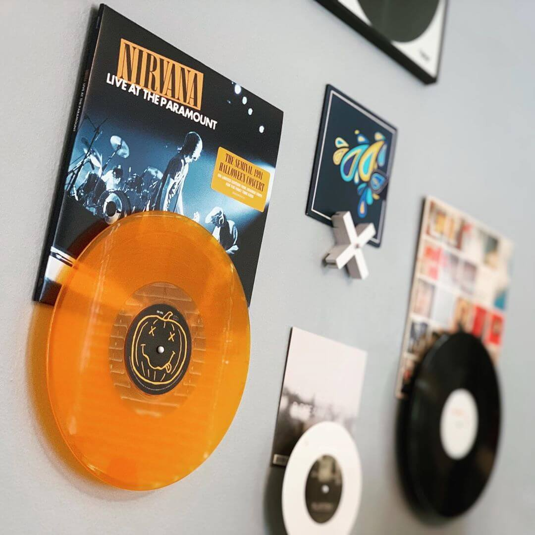 Branded Intent:  For the 20th anniversary of Nirvana's Nevermind, this special edition of their famous Live At The Paramount performance from Halloween night in 2011 was released on orange vinyl for a fitting theme, along with a pumpkin shape in place of the band's classic smiley emblem, placed on the center label. This variant also comes with a poster and a replica of the VIP pass from the show.