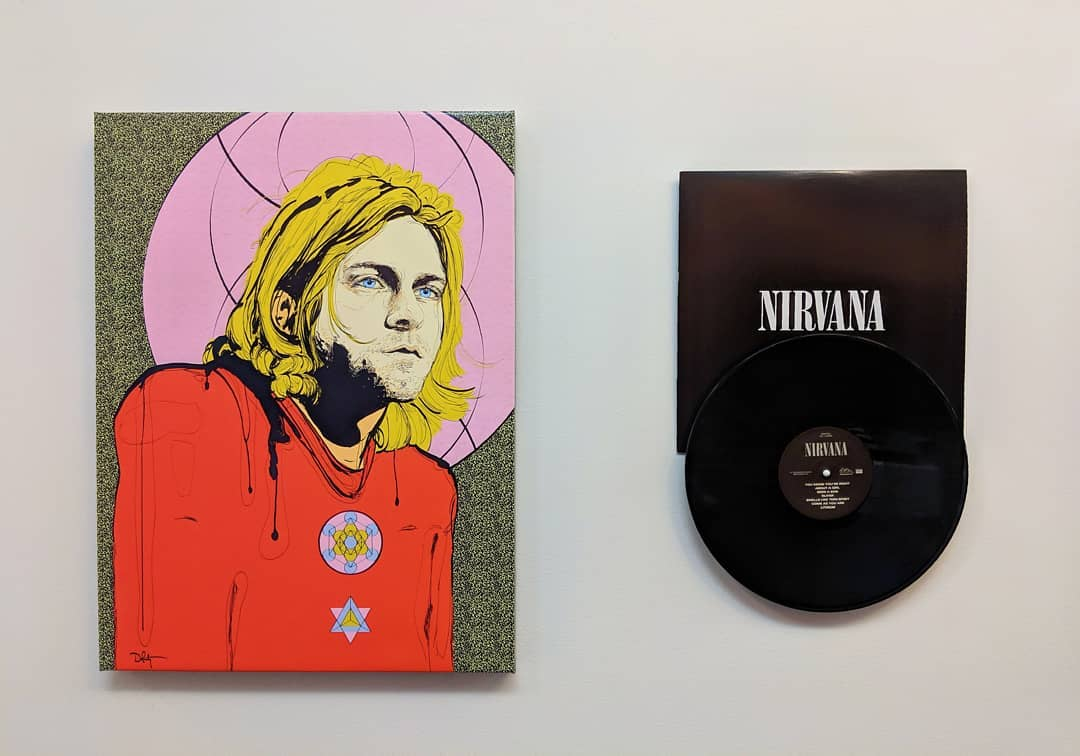 Shout out to coolblueweb for sharing this beautiful setup on their office wall – an ode to Nirvana's Kurt Cobain.