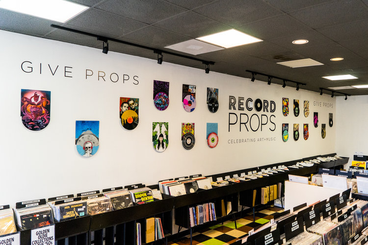 A shot of the    Give Props    installation for Record Store Day 2017 at Cactus Music in Houston, TX featuring unique works on vinyl records by individual artists.