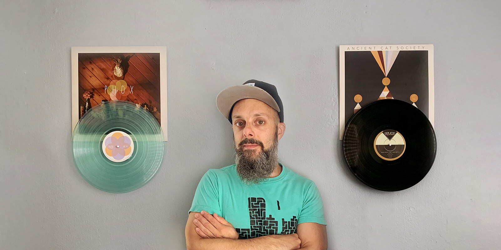 Record Props founder, Tim DeSilva, appreciating a few favorite vinyl record selections. The medium of vinyl provides the means to celebrate both the musicians and the visual artists behind the creation of every album, past and present.