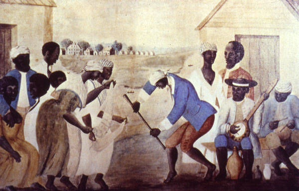 """The Old Plantation,"" South Carolina, about 1790. This famous painting shows Gullah slaves dancing and playing musical instruments derived from Africa. Scholars unaware of the Sierra Leone slave trade connection have interpreted the two female figures as performing a ""scarf"" dance. Sierra Leoneans can easily recognize that they are playing the shegureh, a women's instrument (rattle) characteristic of the Mende and neighboring tribes.   http://www.yale.edu/glc/gullah/cont.htm  [Public domain], via Wikimedia Commons"
