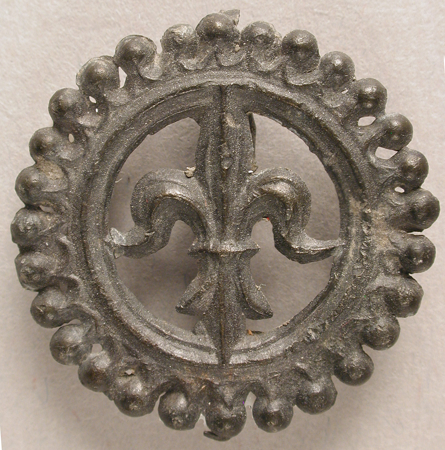 Badge with Lily of Purity, 14th-15th century, tin/lead alloy. Collection of the Metropolitan Museum of Art.