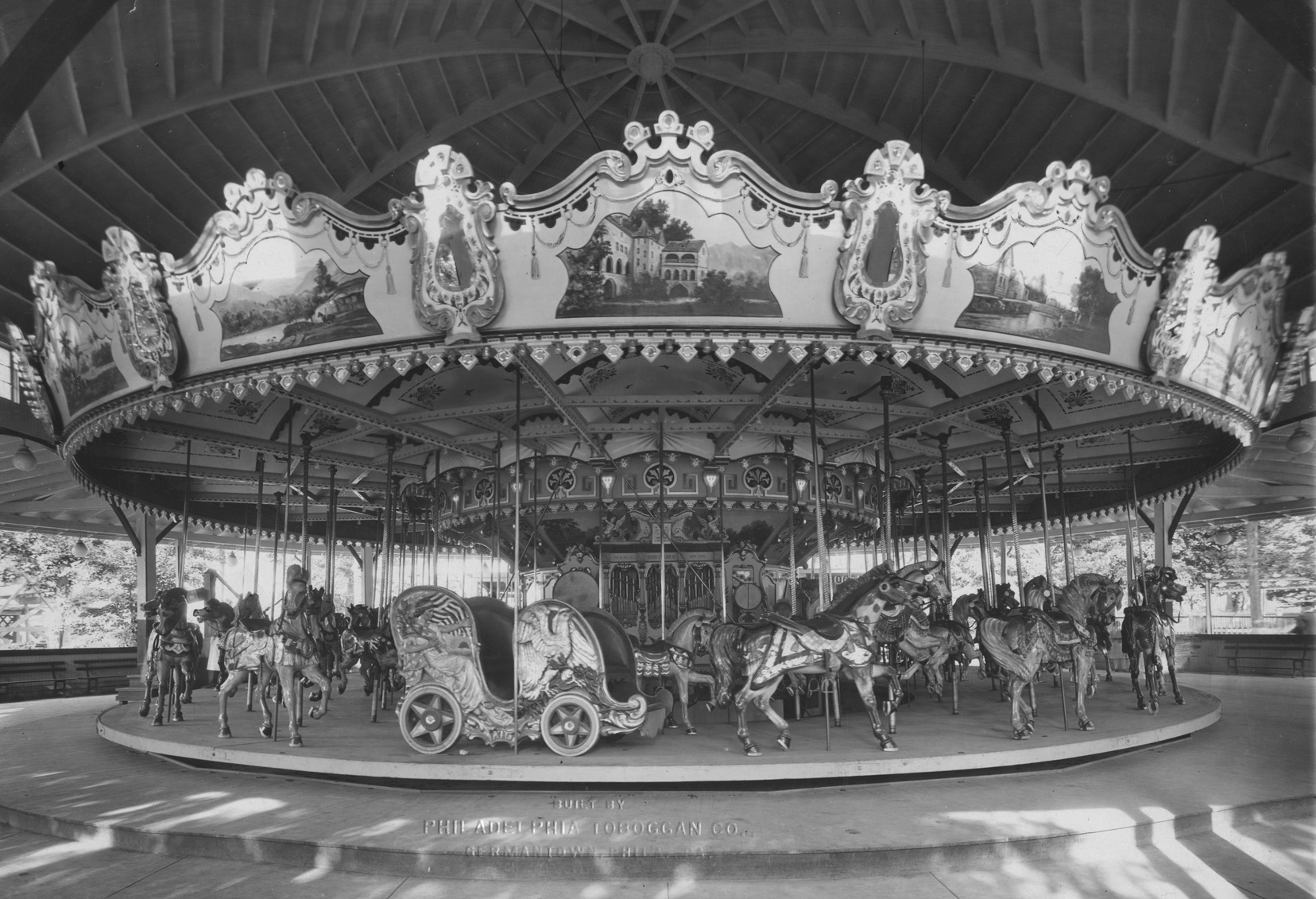 An original wooden carousel crafted by the Philadelphia Toboggan Company.