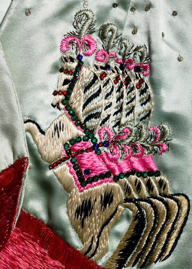 Detailed embroidery and embellishment is a hallmark of Schiaparelli's illustrative work.