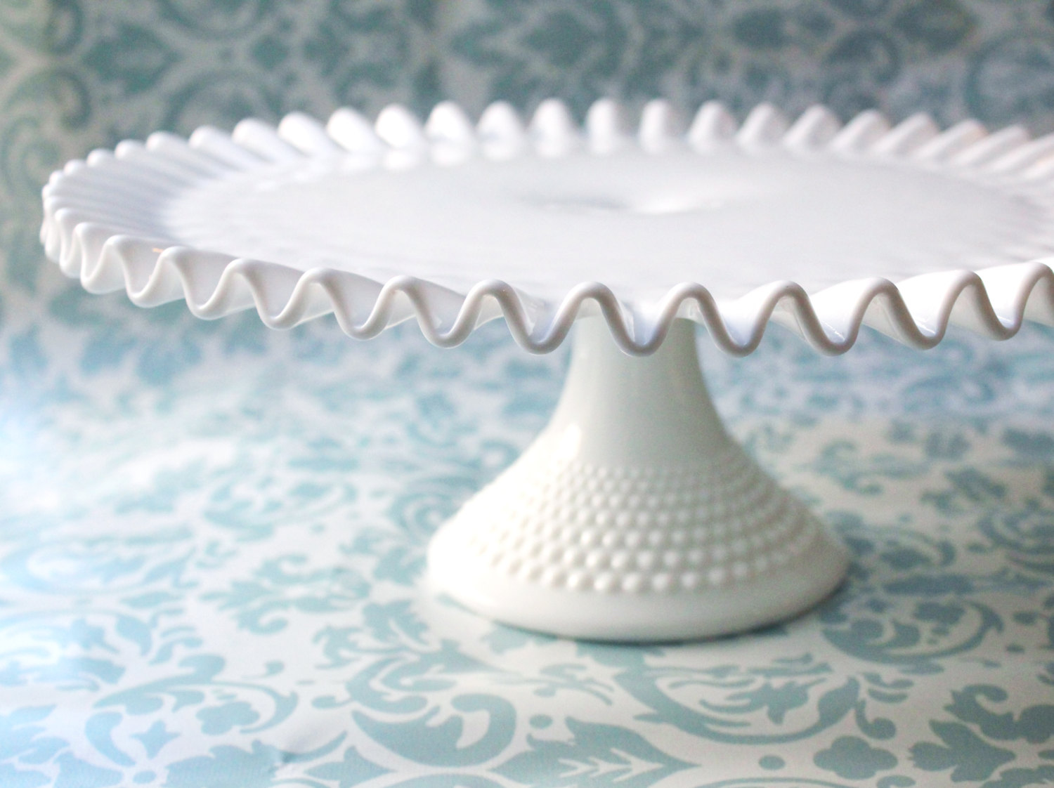 Fenton Company hobnail milk glass cake stand.  Image from  Roche Studio Vintage  on Etsy.