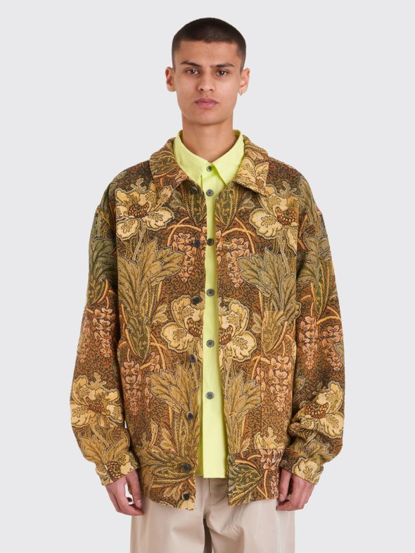 A workwear jacket constructed from an antique French tapestry. From  Tres Bien , one of Bode's stockists.
