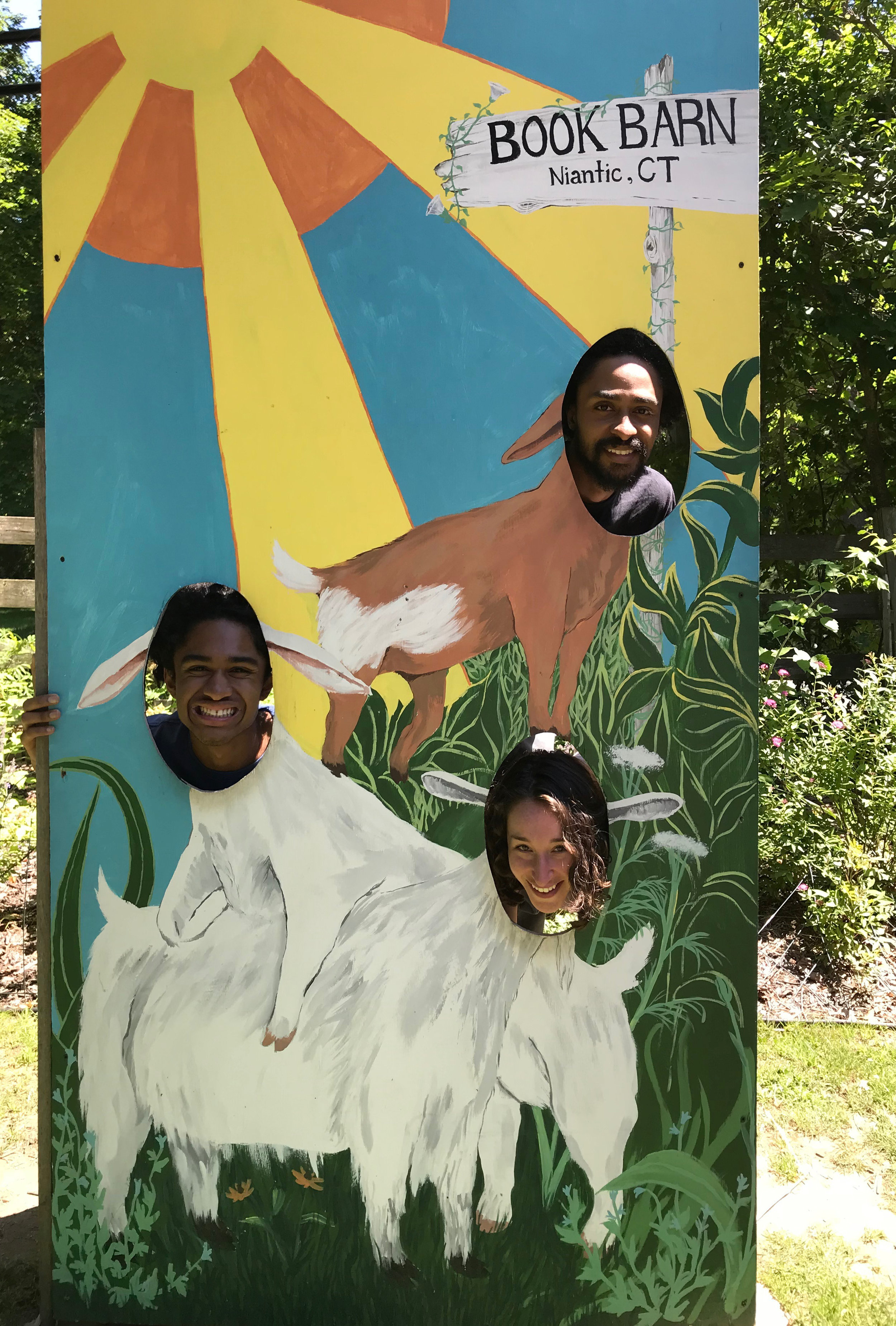 One of the many hand painted elements around the grounds, this fun photo-op celebrates the actual goats that call The Book Barn home.