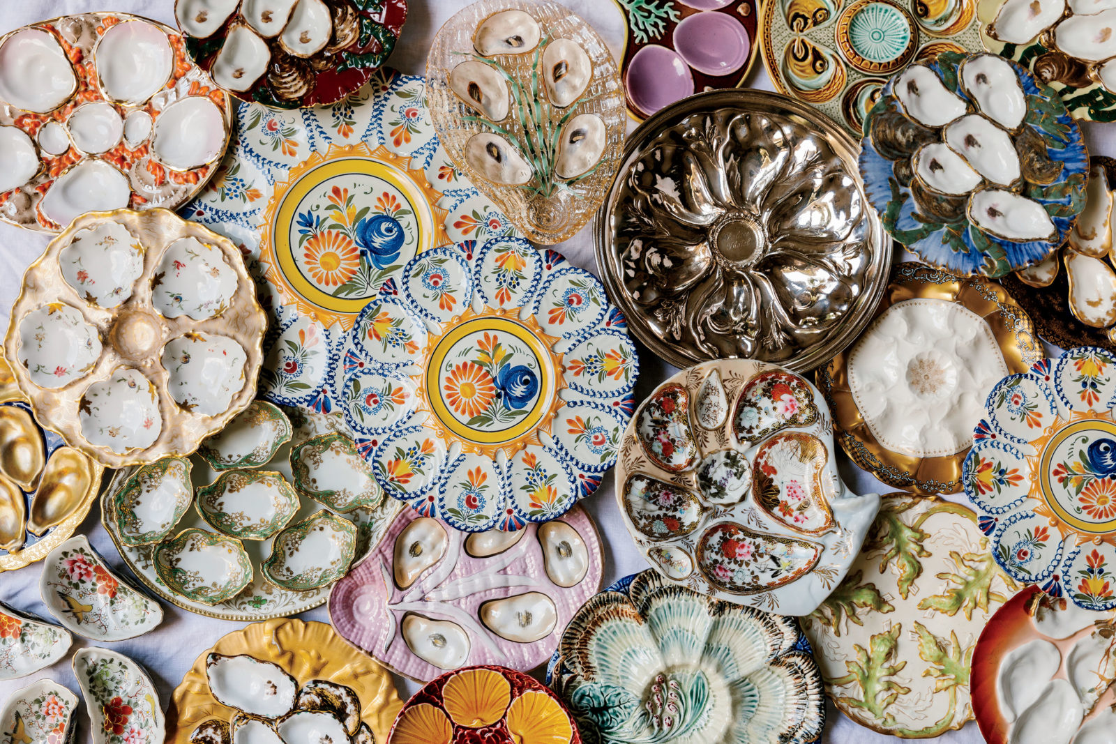 Linda Peterson's collection of oyster plates, photographed by Kathryn McCrary for  Garden & Gun Magazine .