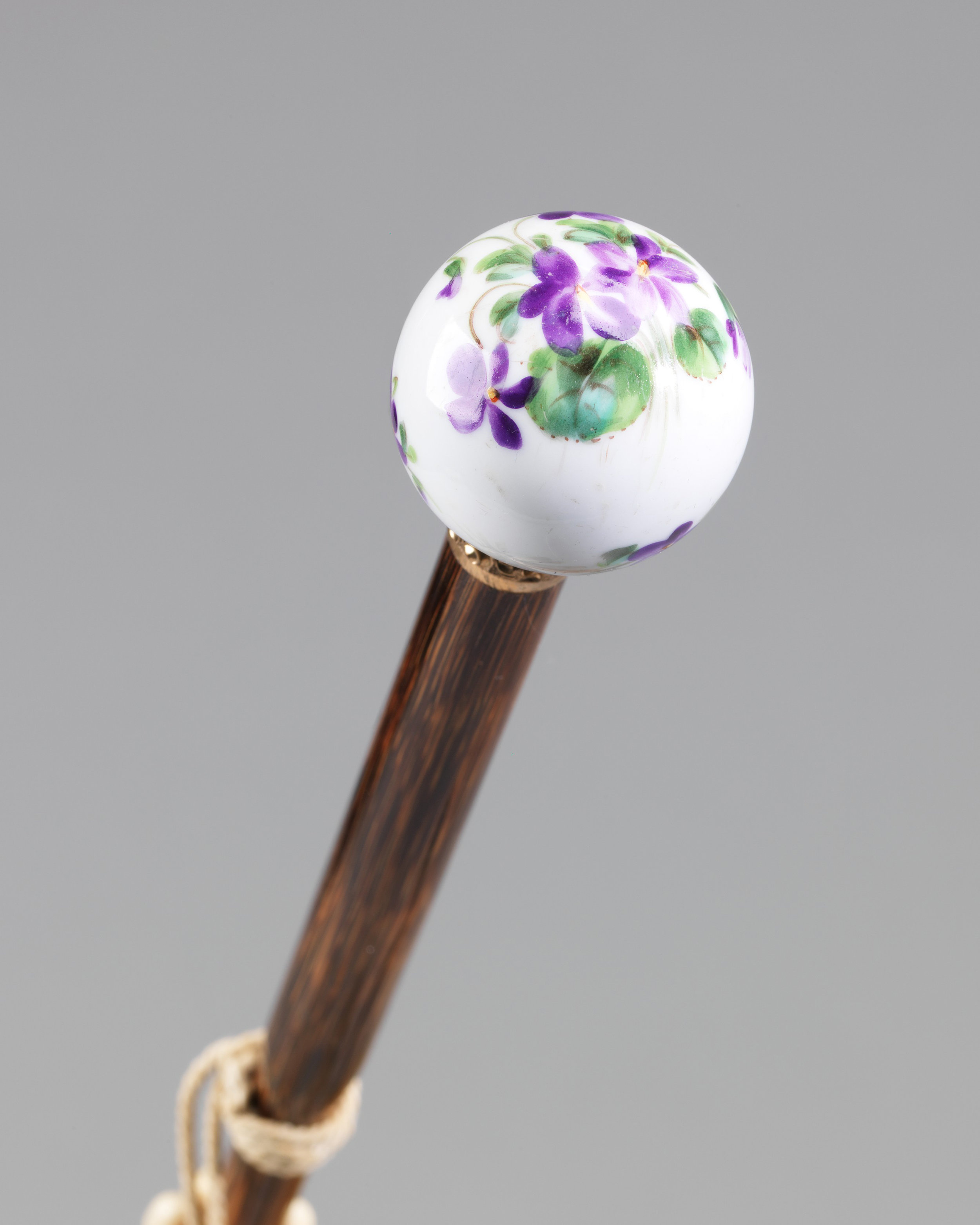 Hand painted porcelain ball handle.