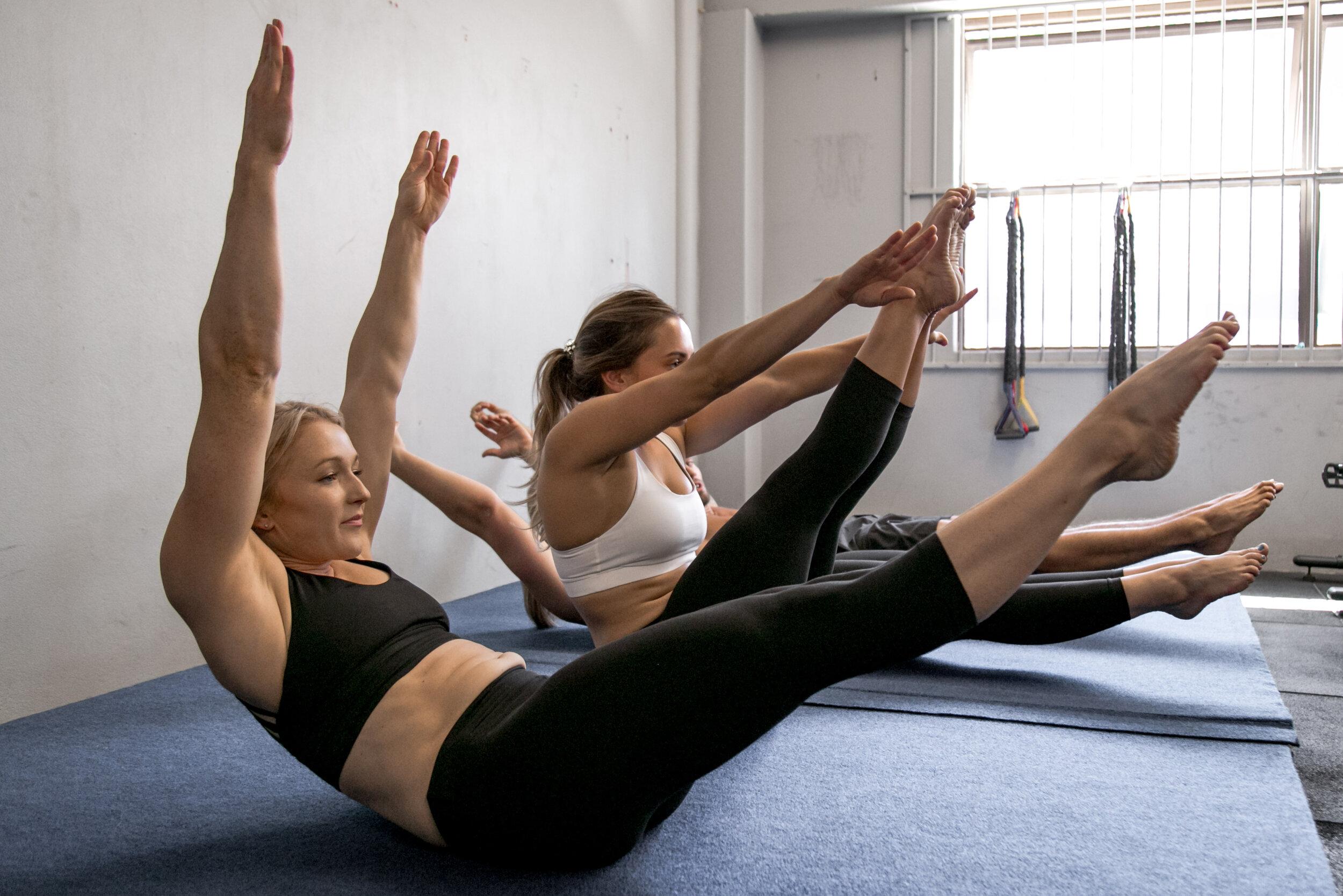Female gymnasts completing training plan. V snaps.