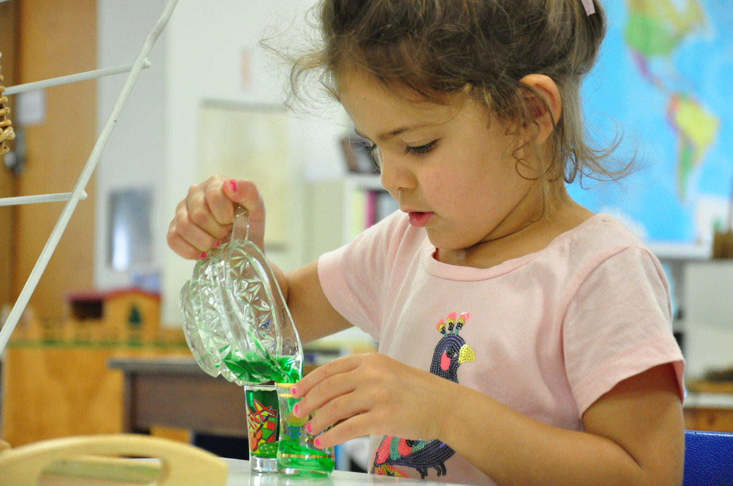 Learning fine motor and practical life skills through a pouring activity