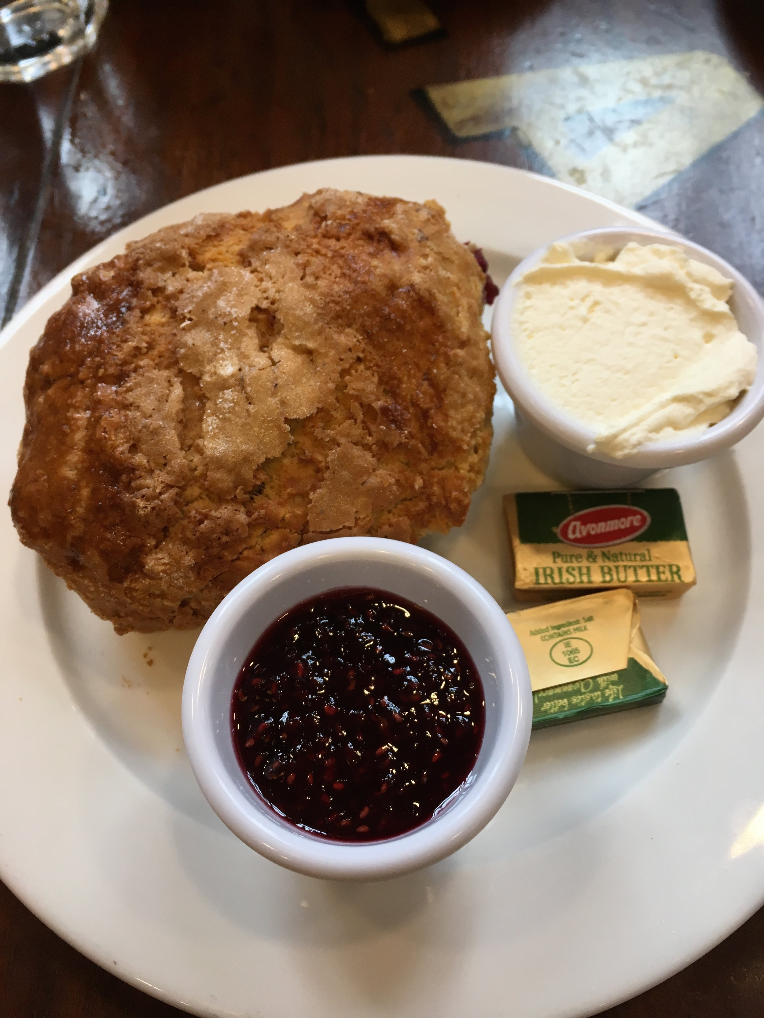 Mixed berry scone with homemade jam and clotted cream