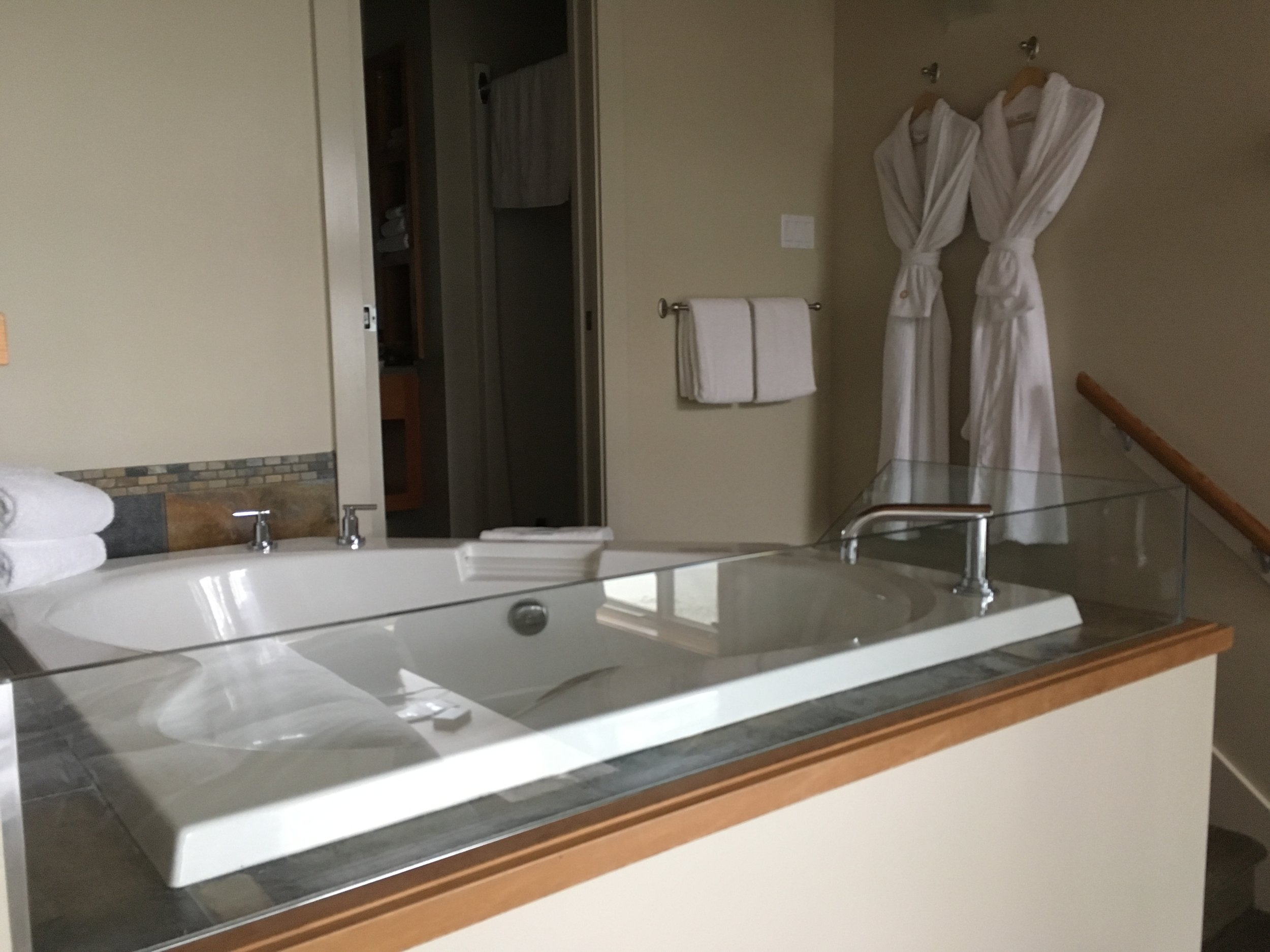 The Master Bedroom in our Beach House has a soaker tub in the bedroom