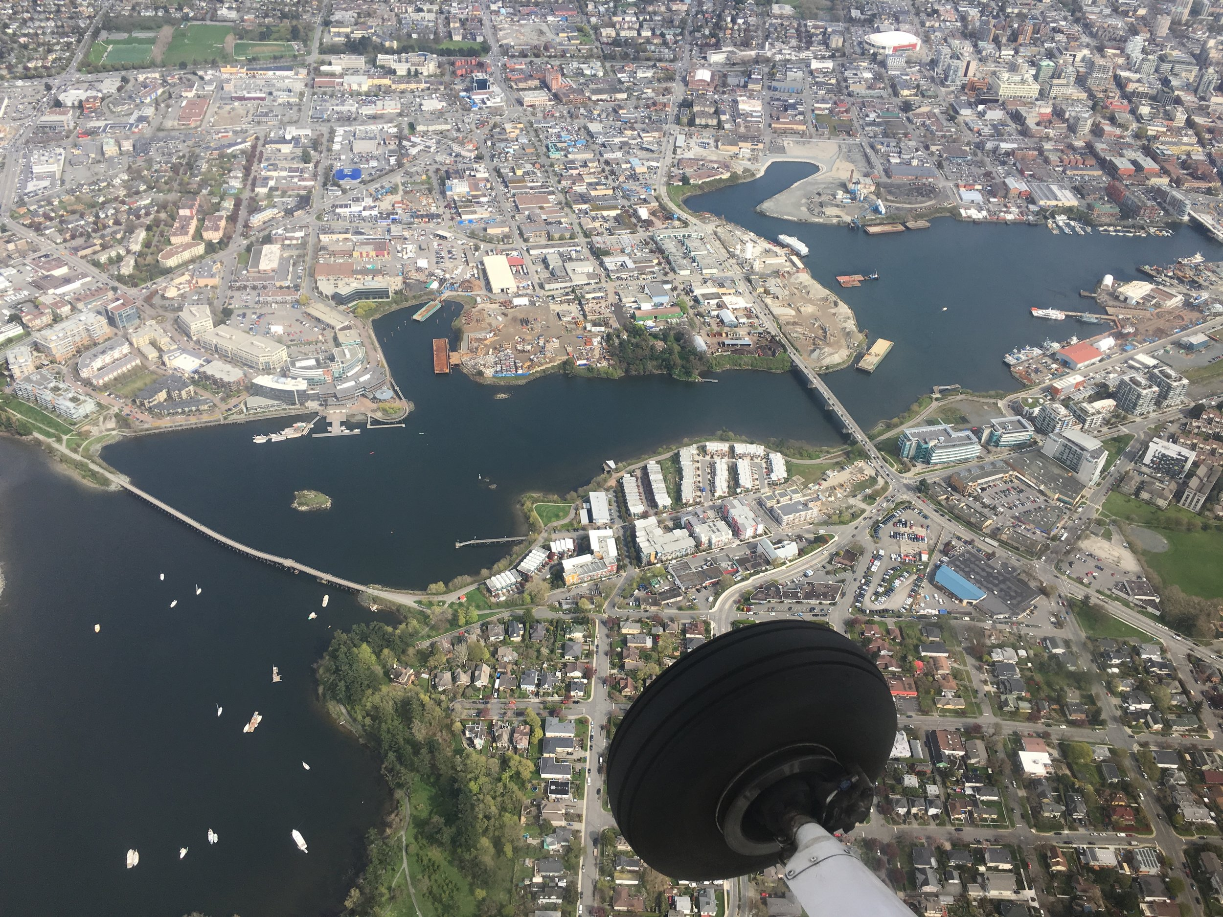 Flying over the Victoria's downtown harbour