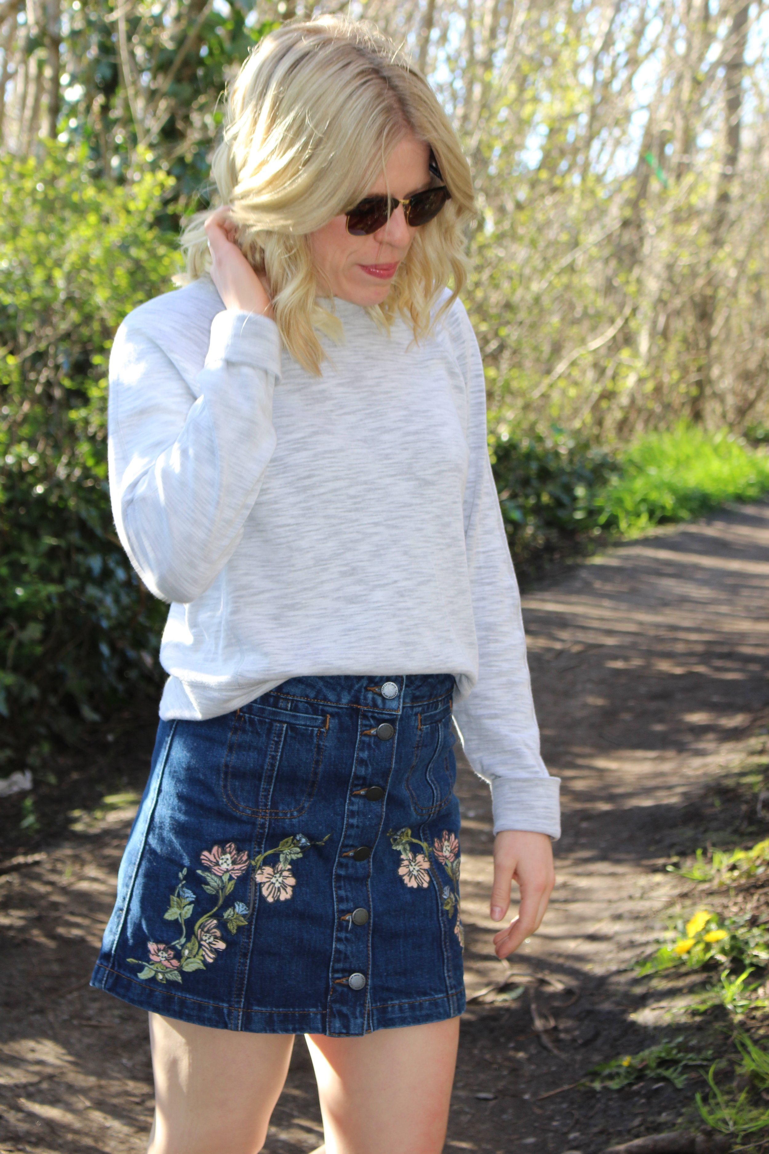Topshop  Denim Mini,  Lululemon  Sweatshirt,  Ray-Ban  Sunglasses,  Converse  Sneakers