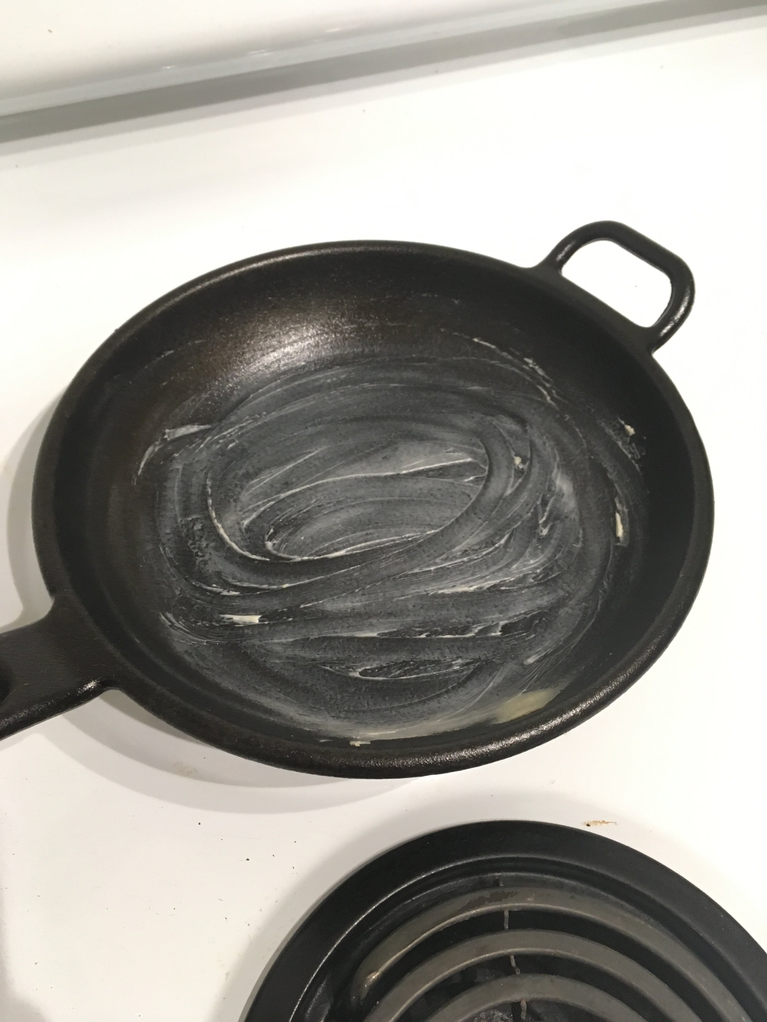 Buttered cast-iron pan