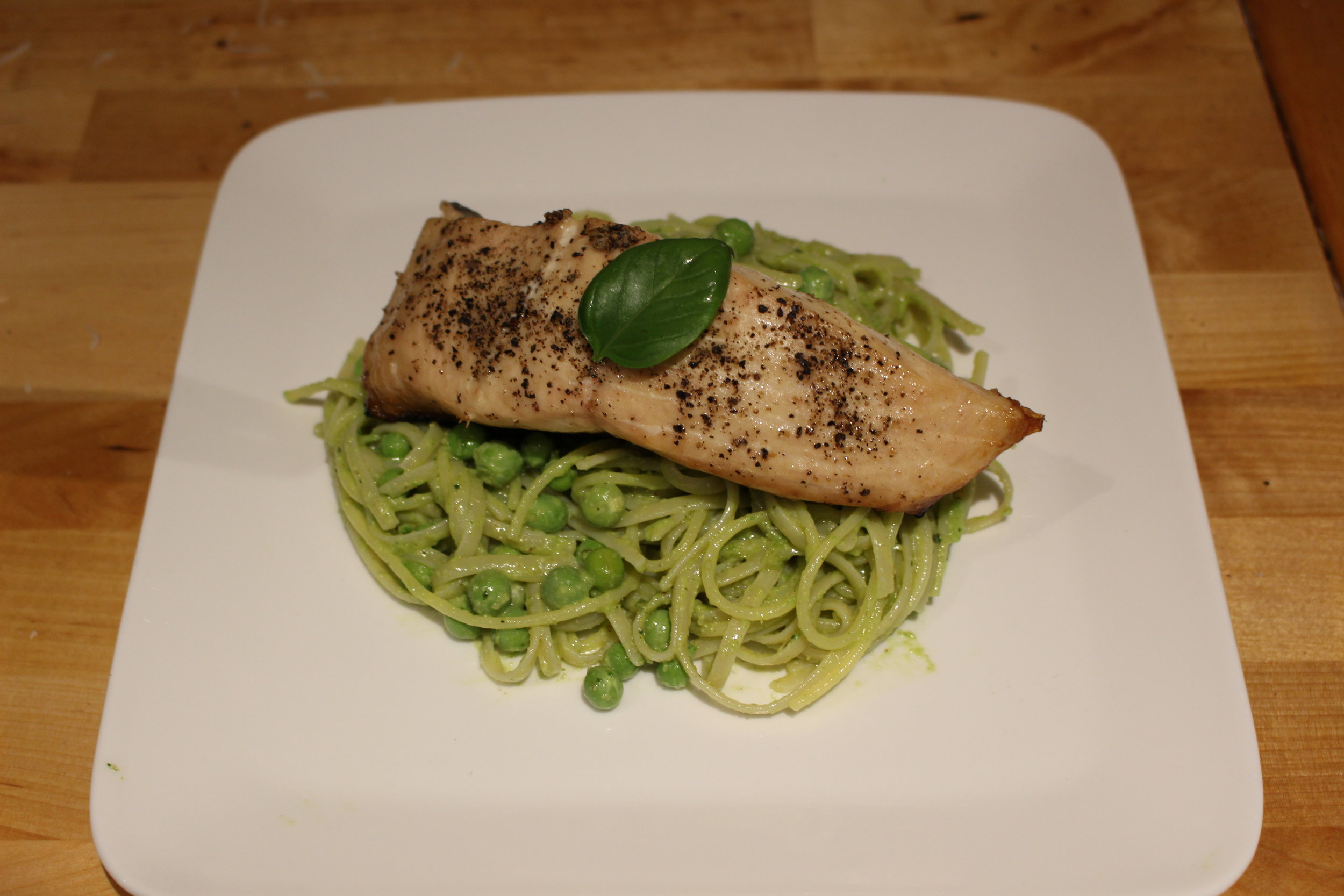 Pesto pasta with peas and white Chinook Salmon